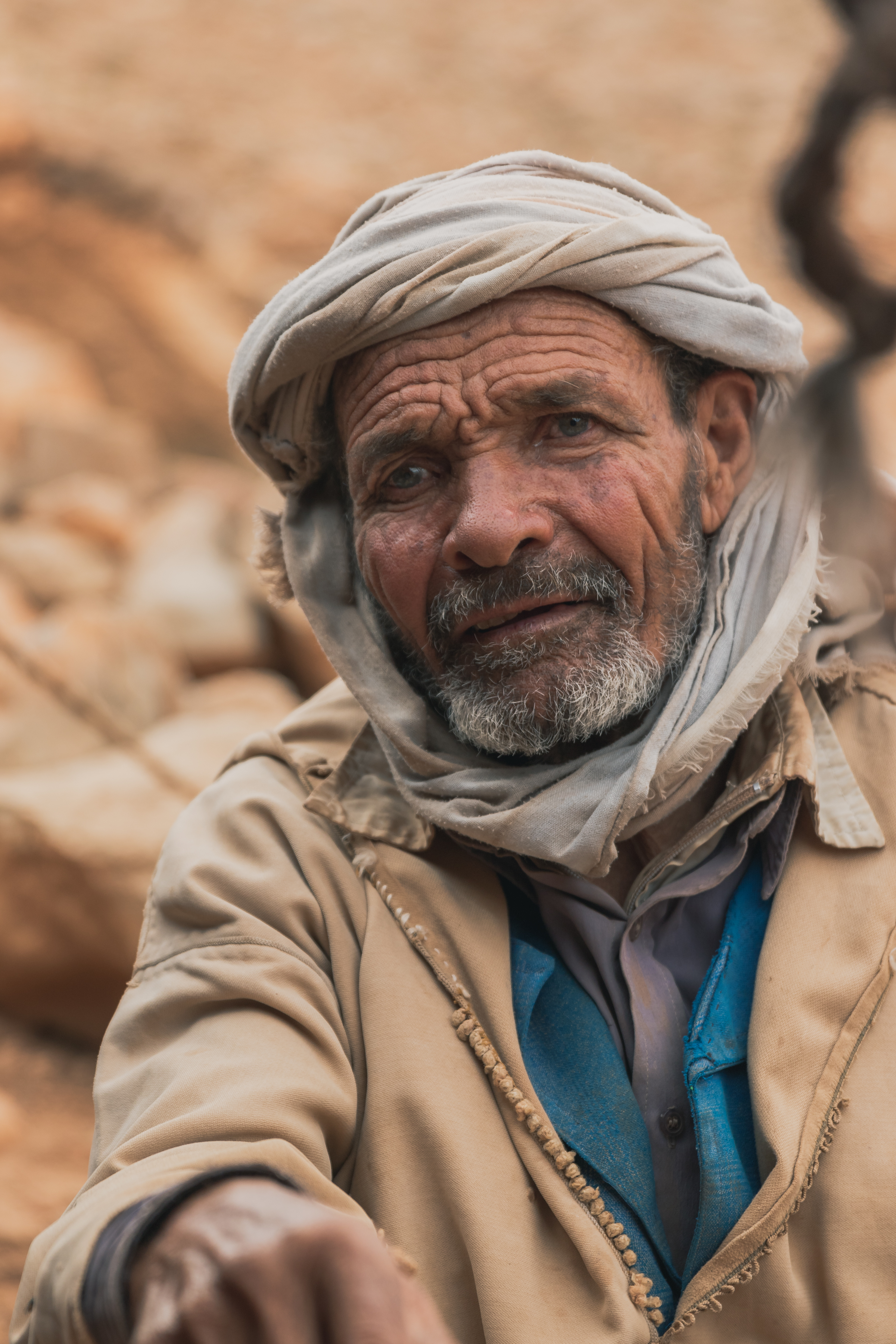 moroccan male nomad captured in a nomad village while taking a break from hiking