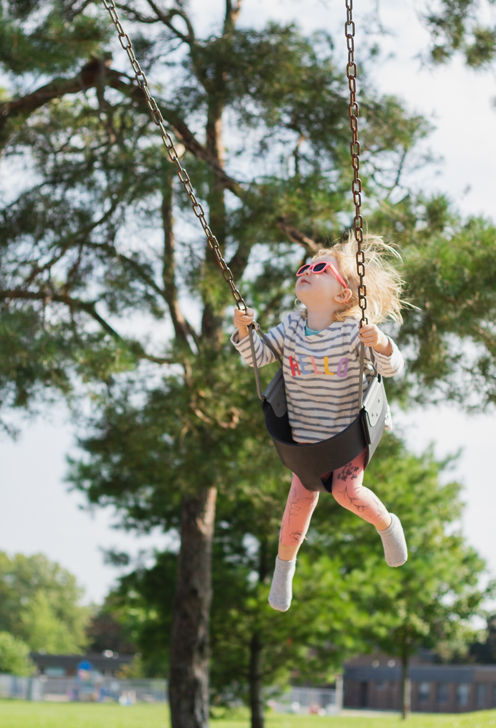 portrait of child swinging on a swing