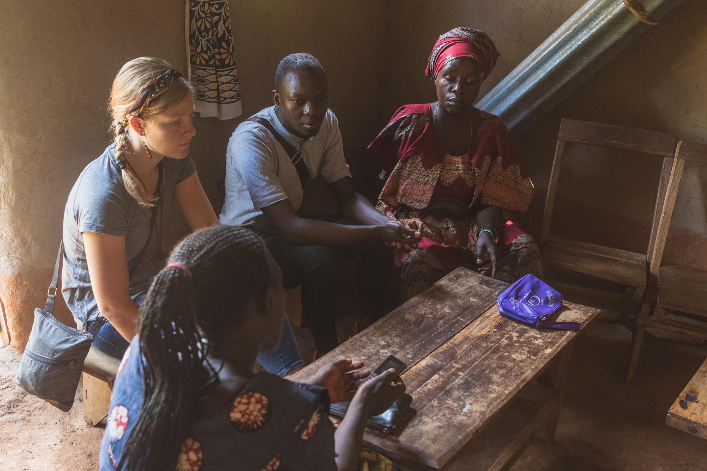 meeting in rural rwandan house