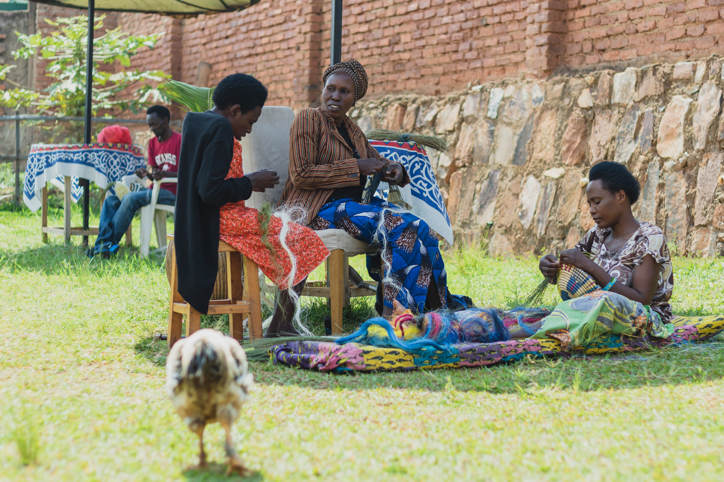women with disabilities weaving baskets for an income in rwanda