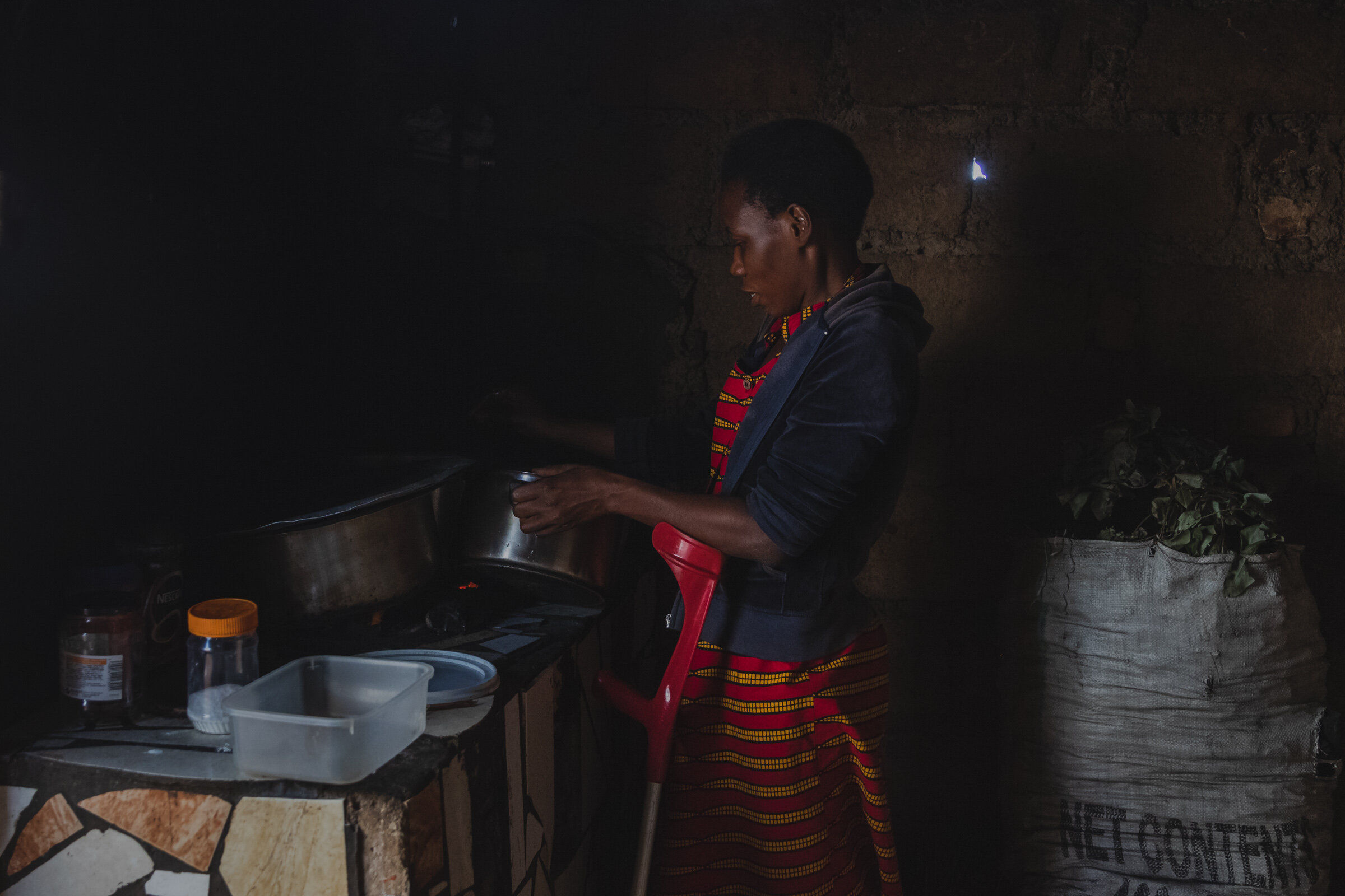 woman with a disability working in a kitchen in rwanda photographed for talking through art and photographers without borders