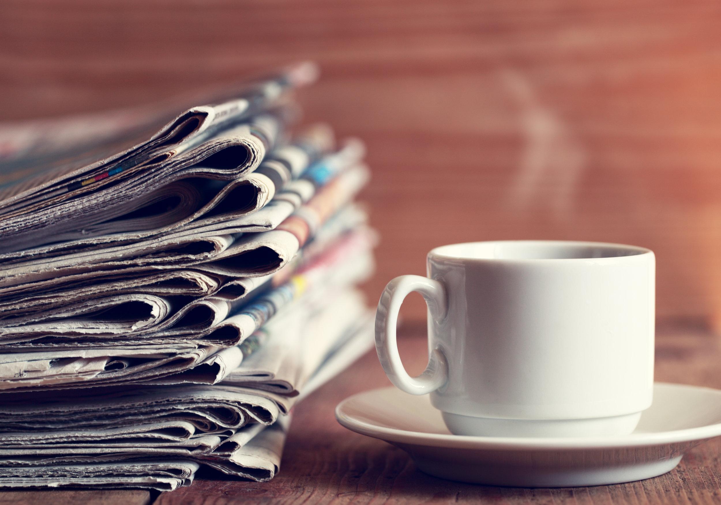newspaper and coffee.jpeg