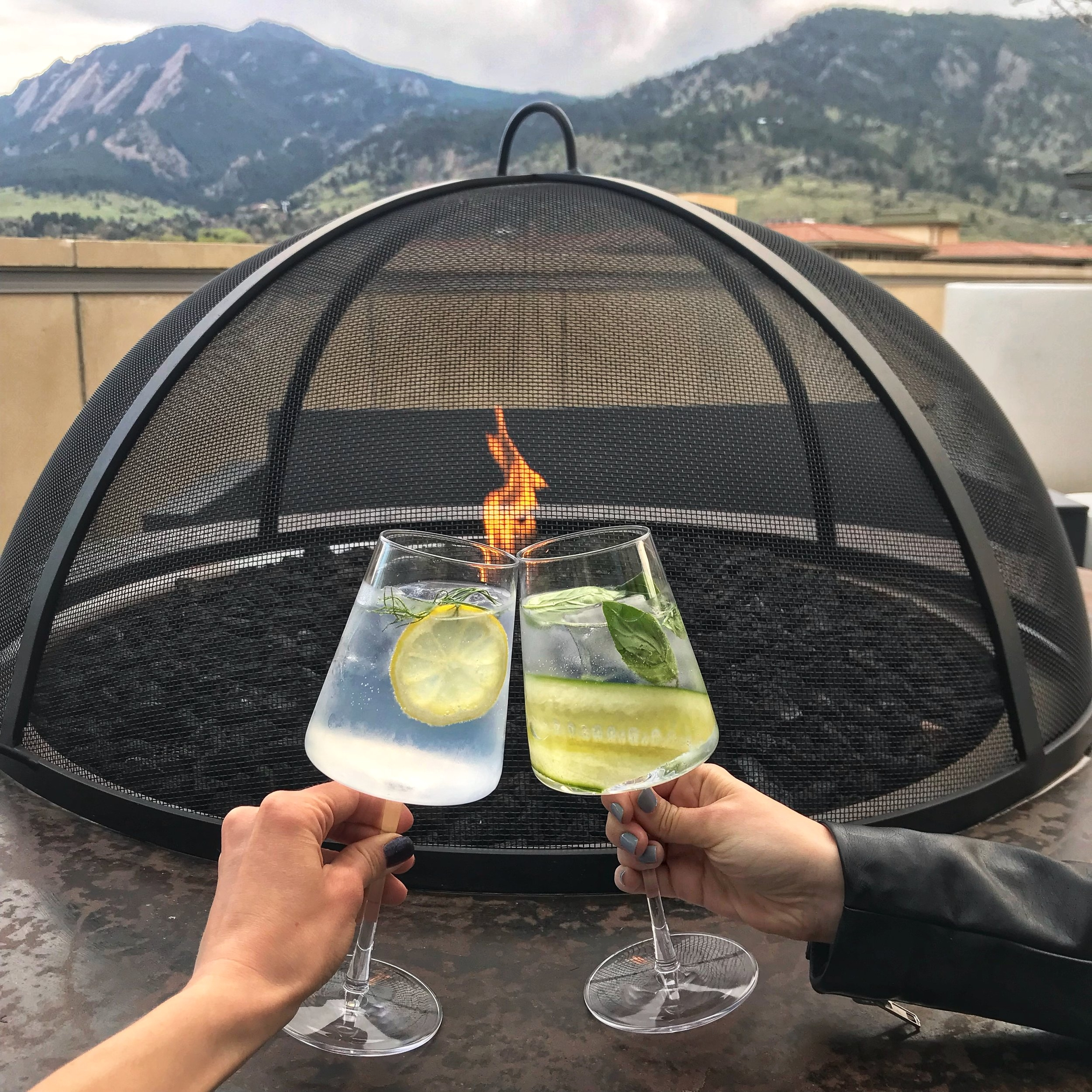 Why we love it: great tapas, fancy cocktails, excellent service  Corrida is a new Spanish style steakhouse in Boulder. They have arguably the best rooftop patio we've ever been to. With sprawling mountain views, fun lounge seats, fire pits, and indoor/outdoor bar seating, they have created something really special. Here we have the gin and tonics, which are prepared for you table-side. We each ordered a different type - they have 5 different options - and both were super refreshing. Without getting into it too much, the food is excellent (see previous blog post on our full review). It is definitely more of an upscale dining spot, but rumor has it they will be rolling out a happy hour menu soon!