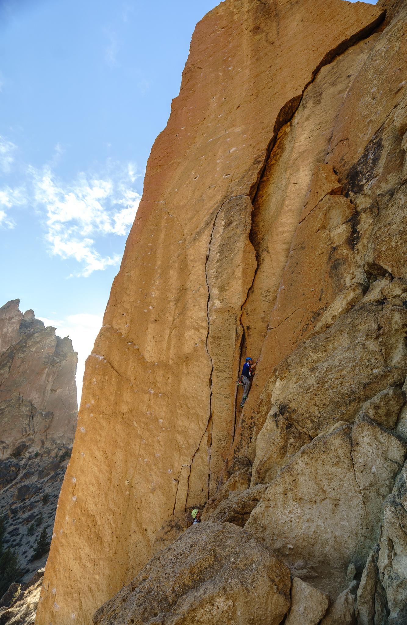 Climber's trad climbing (placing their own gear)