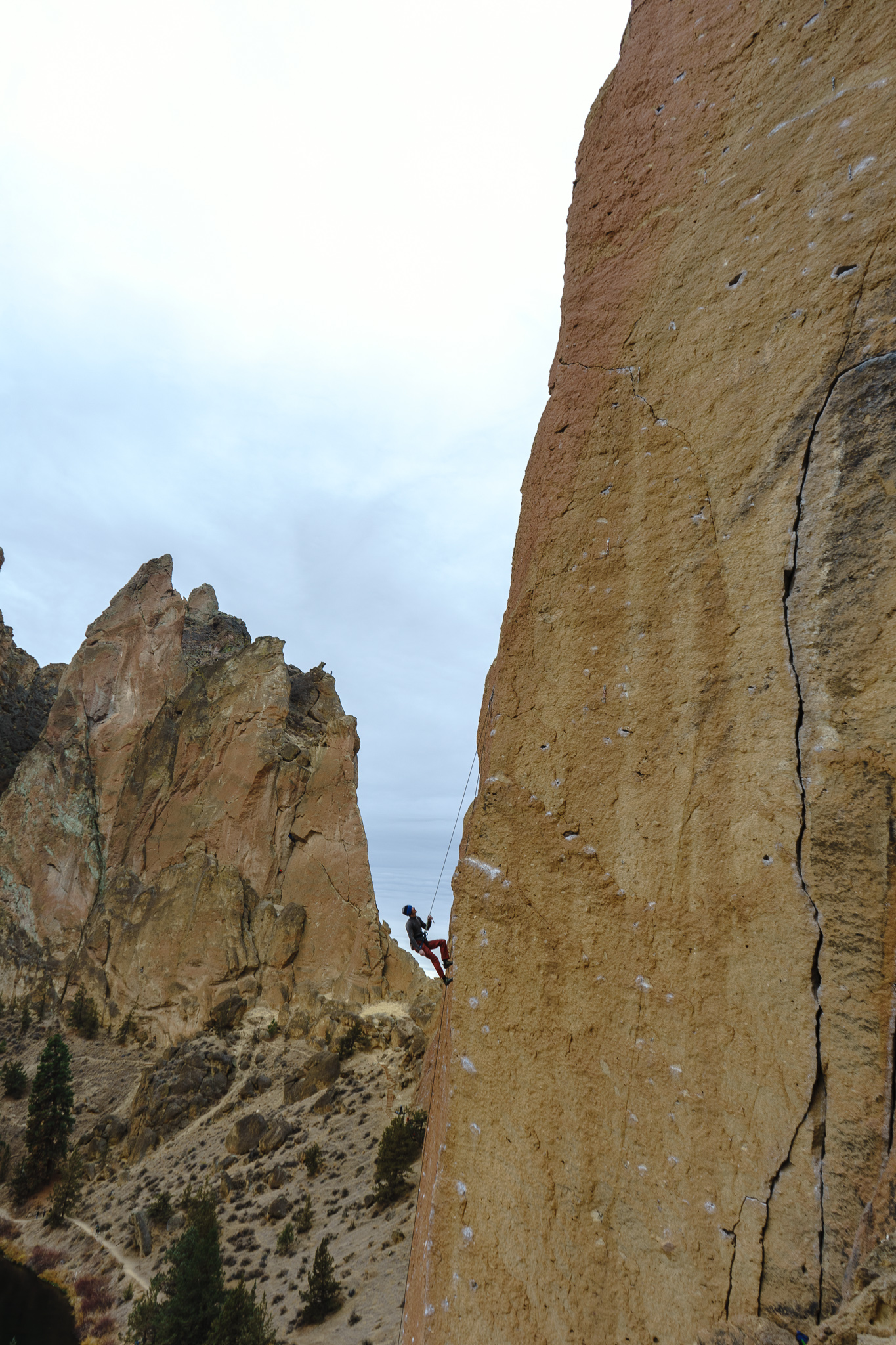 Climber staring at his route