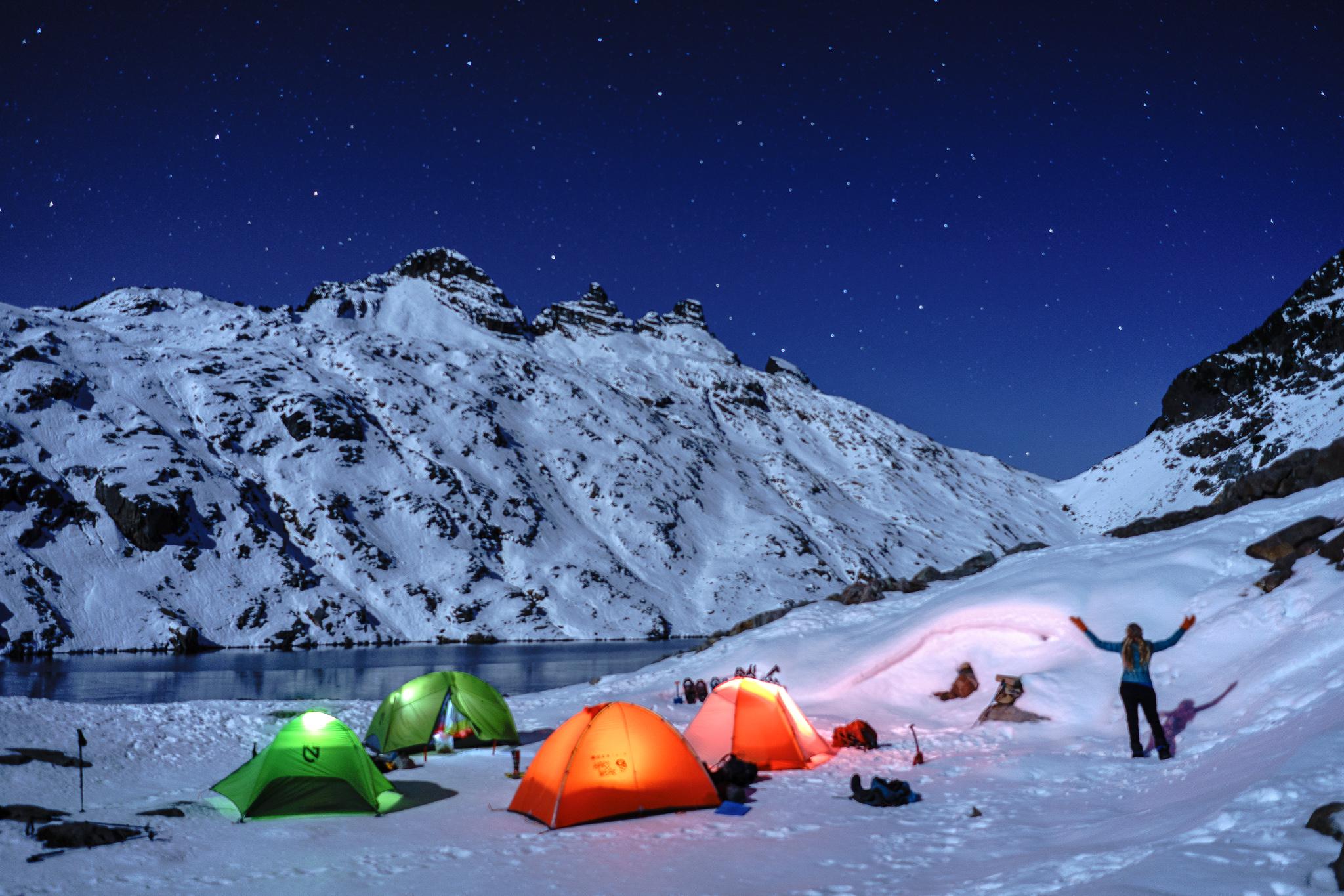 Lit up tents + night sky