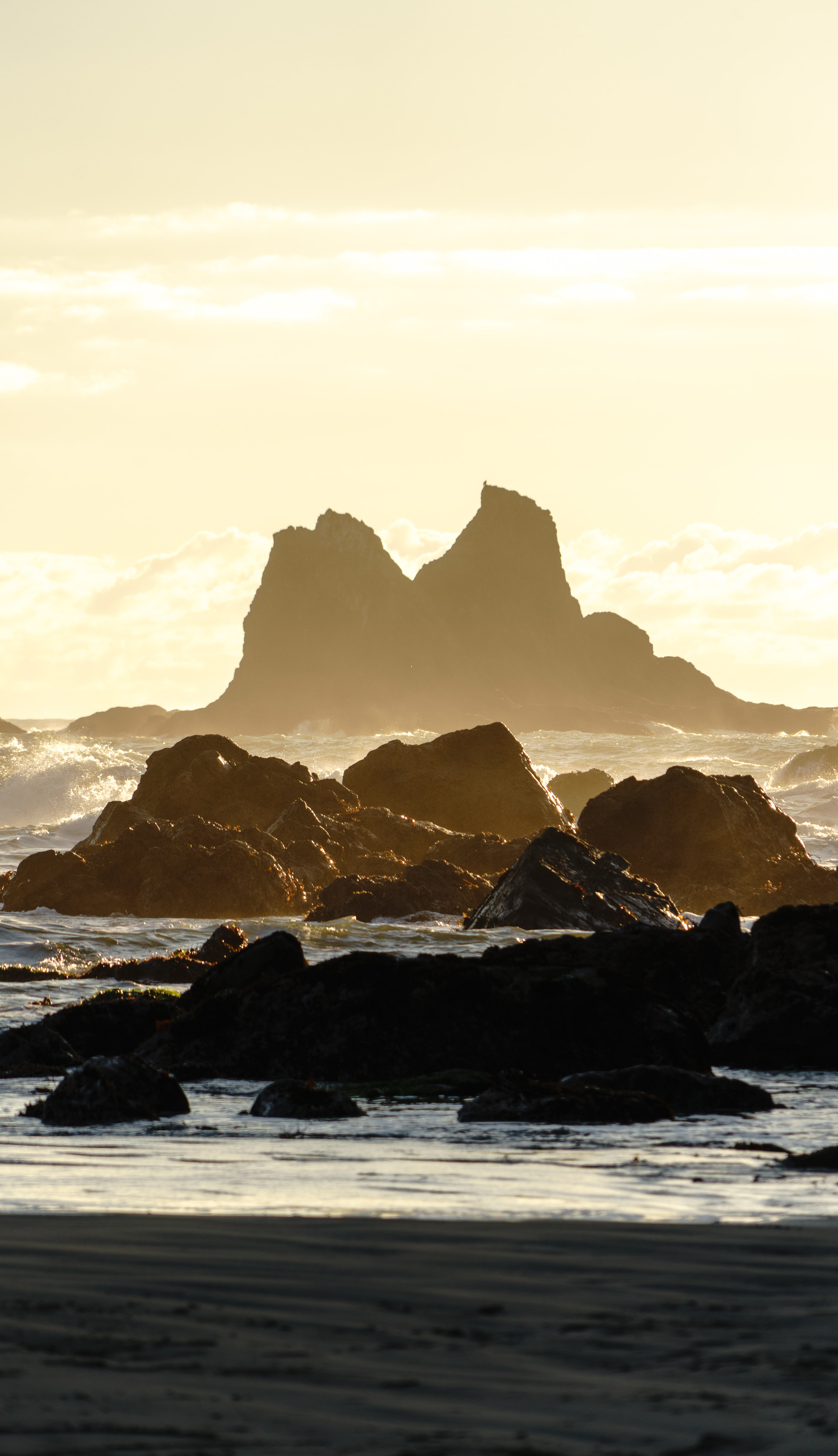 Then golden hour came. Sea stacks rose from the waves like mountains.