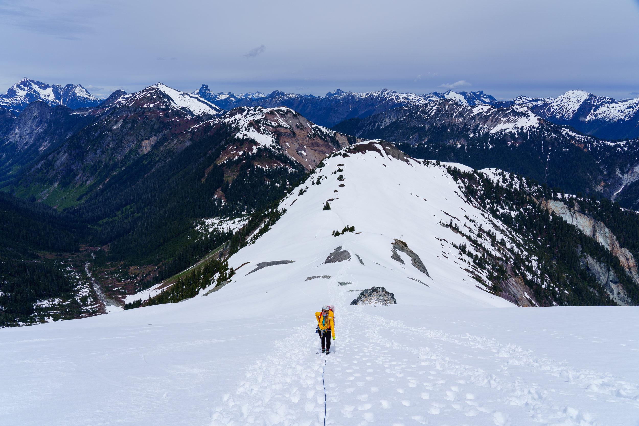Nikki behind me, North Cascades behind her