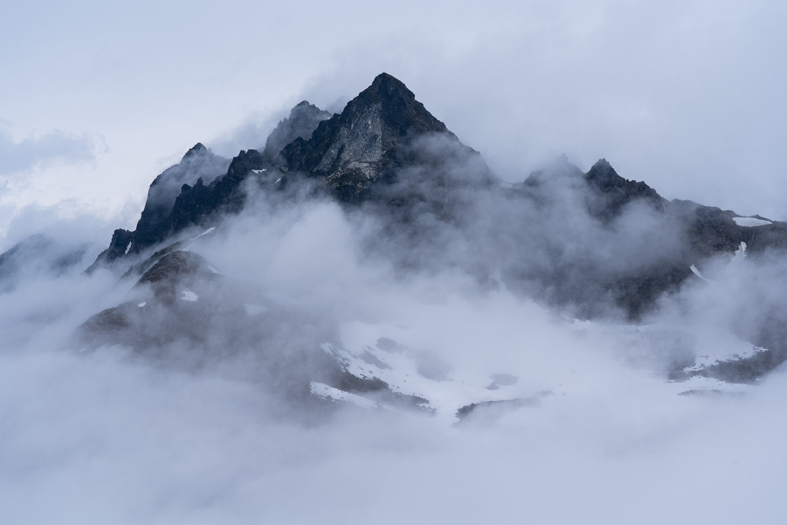Clouds dancing around peaks