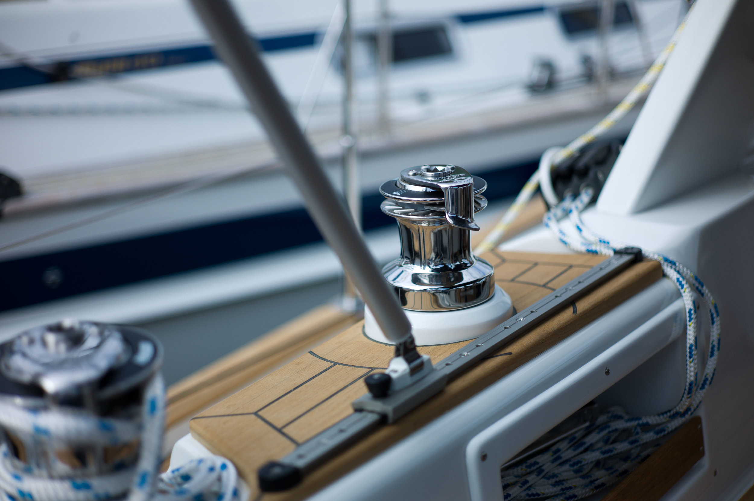 The beauty of well maintained teak and polished winches on a Malø Yacht from Sweden. Photo by Daniel Novello