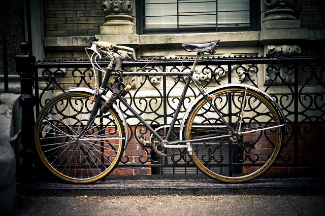 A locked bicycle in Amsterdam. Photo by Daniel Novello