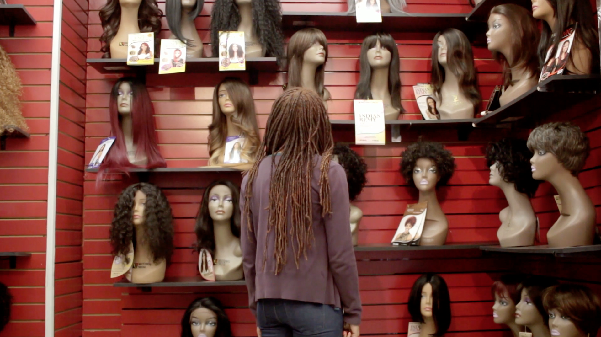 Eva navigating her way through a Black beauty supply store, from  Like Fine Silk.
