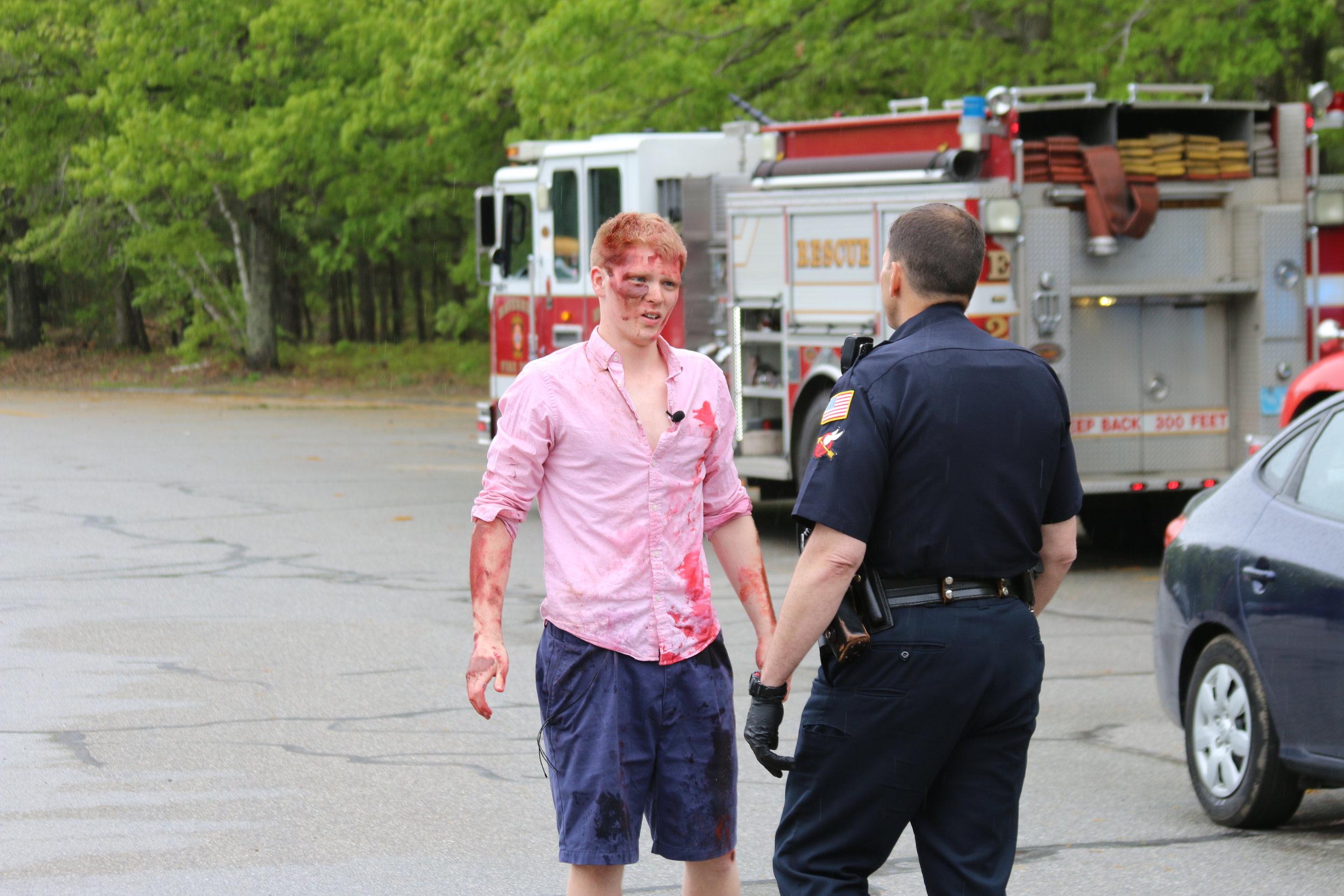 mock crash boy with cop.JPG