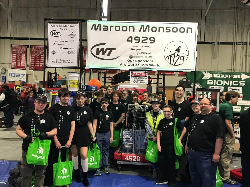 FIRST Robotics Team shot w robot.JPG