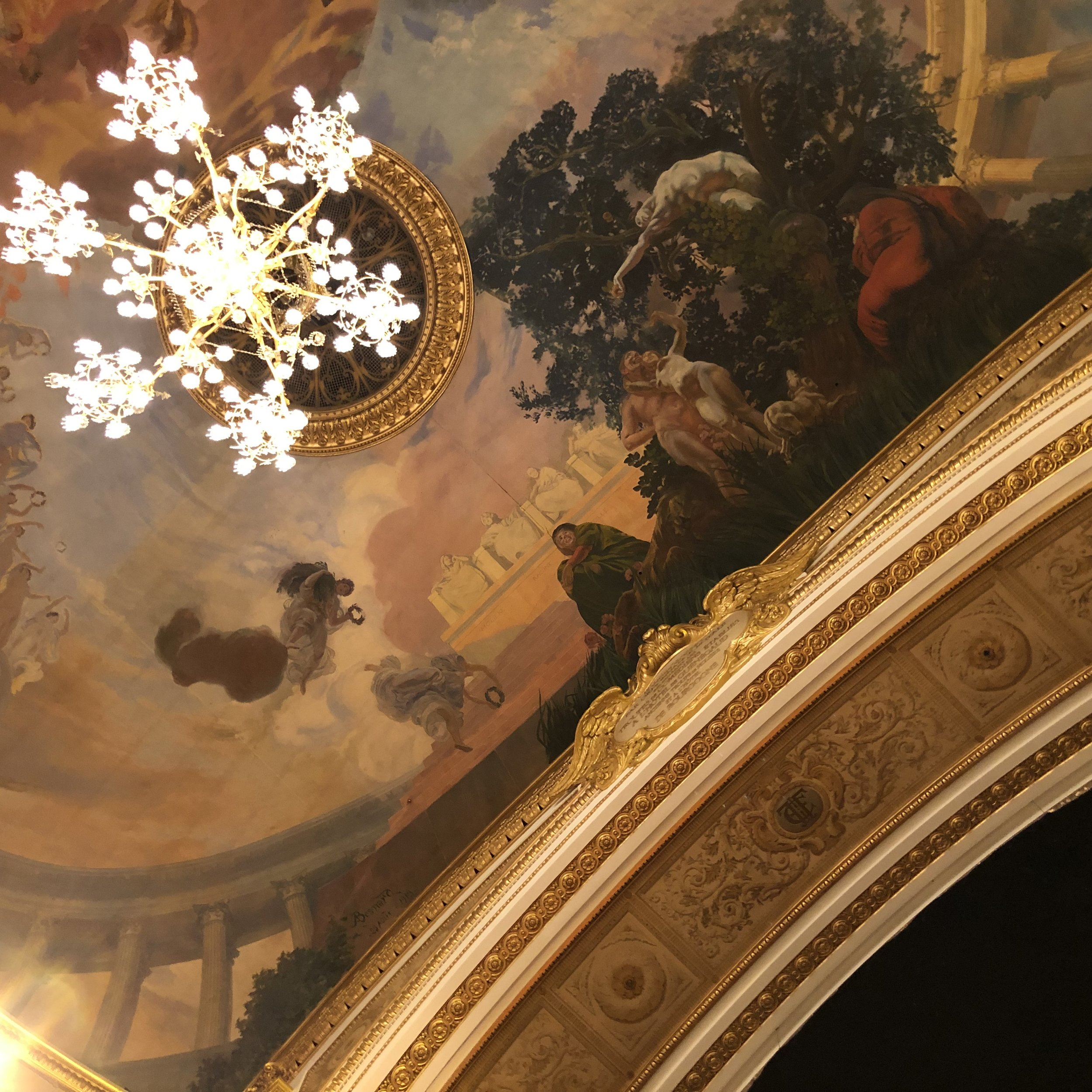 The elaborate ceiling and detail of the proscenium arch of the Salle Richelieu