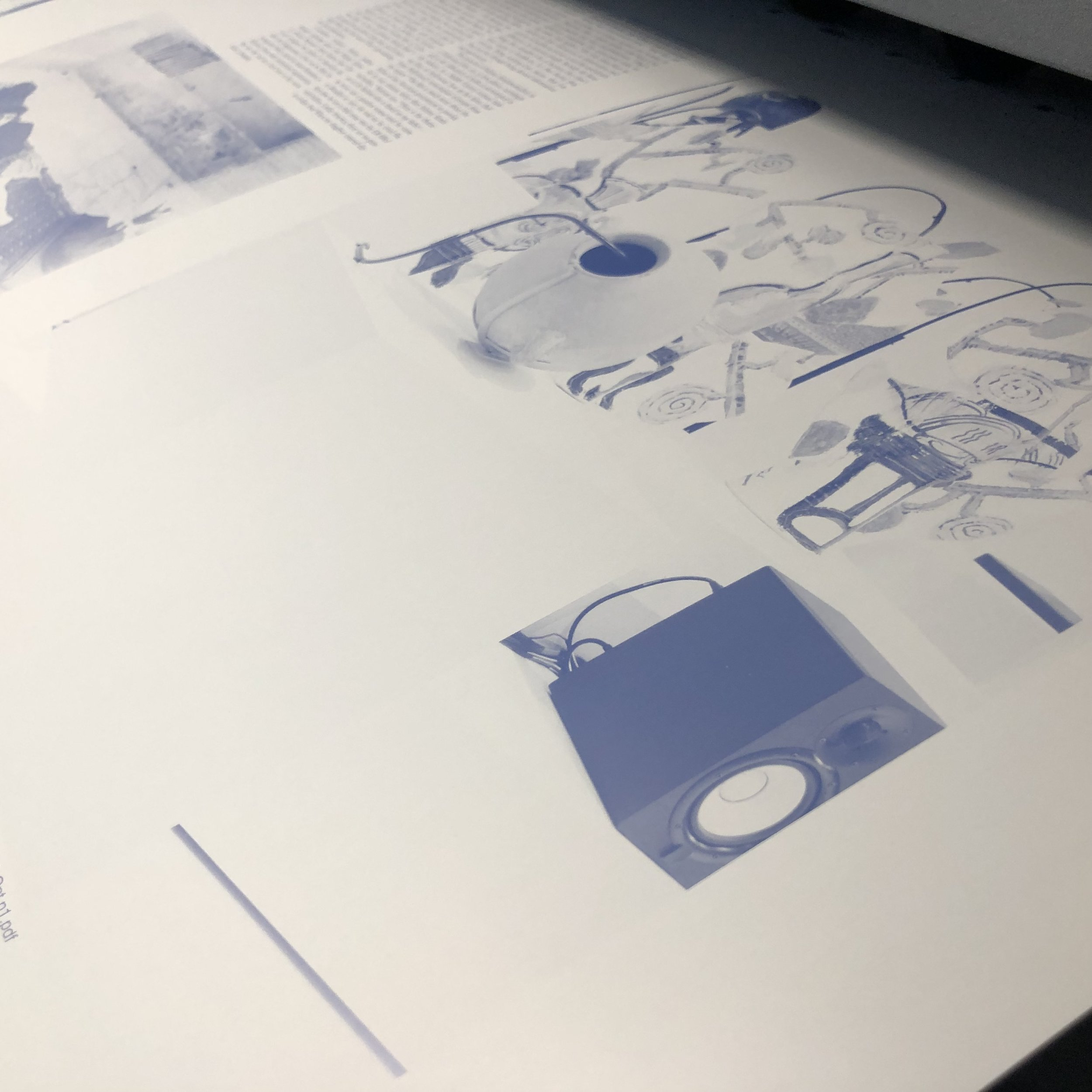 Part of a spread on an off-set litho plate having been etched.
