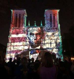 light show on the wall of a cathedal