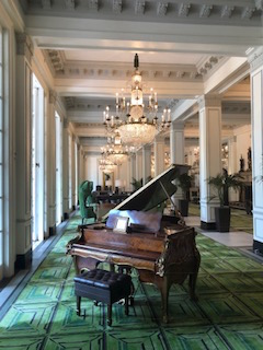 Vintage piano in the historic St. Anthony Hotel Lobby.