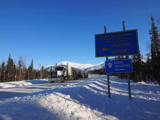 Ice trucker passing Coldfoot Camp (population 10) at Mile 175