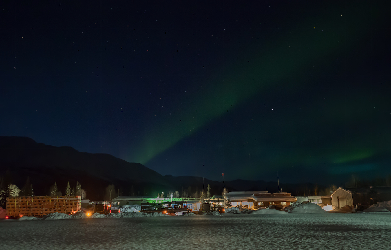 Northern Lights peaking out over the Coldfoot gas station and rest stop.