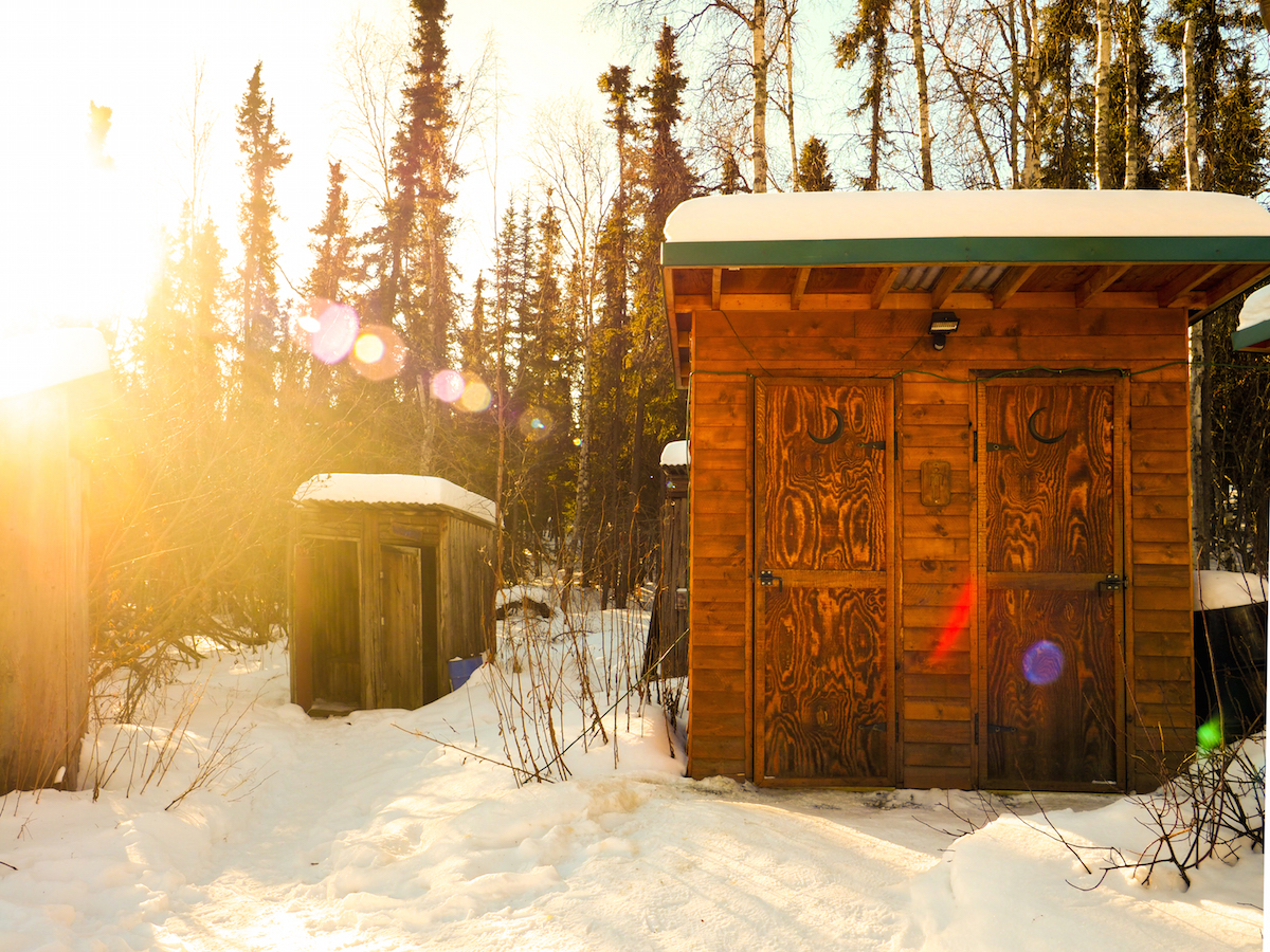 Outhouses on an abandoned homestead near the Arctic Circle