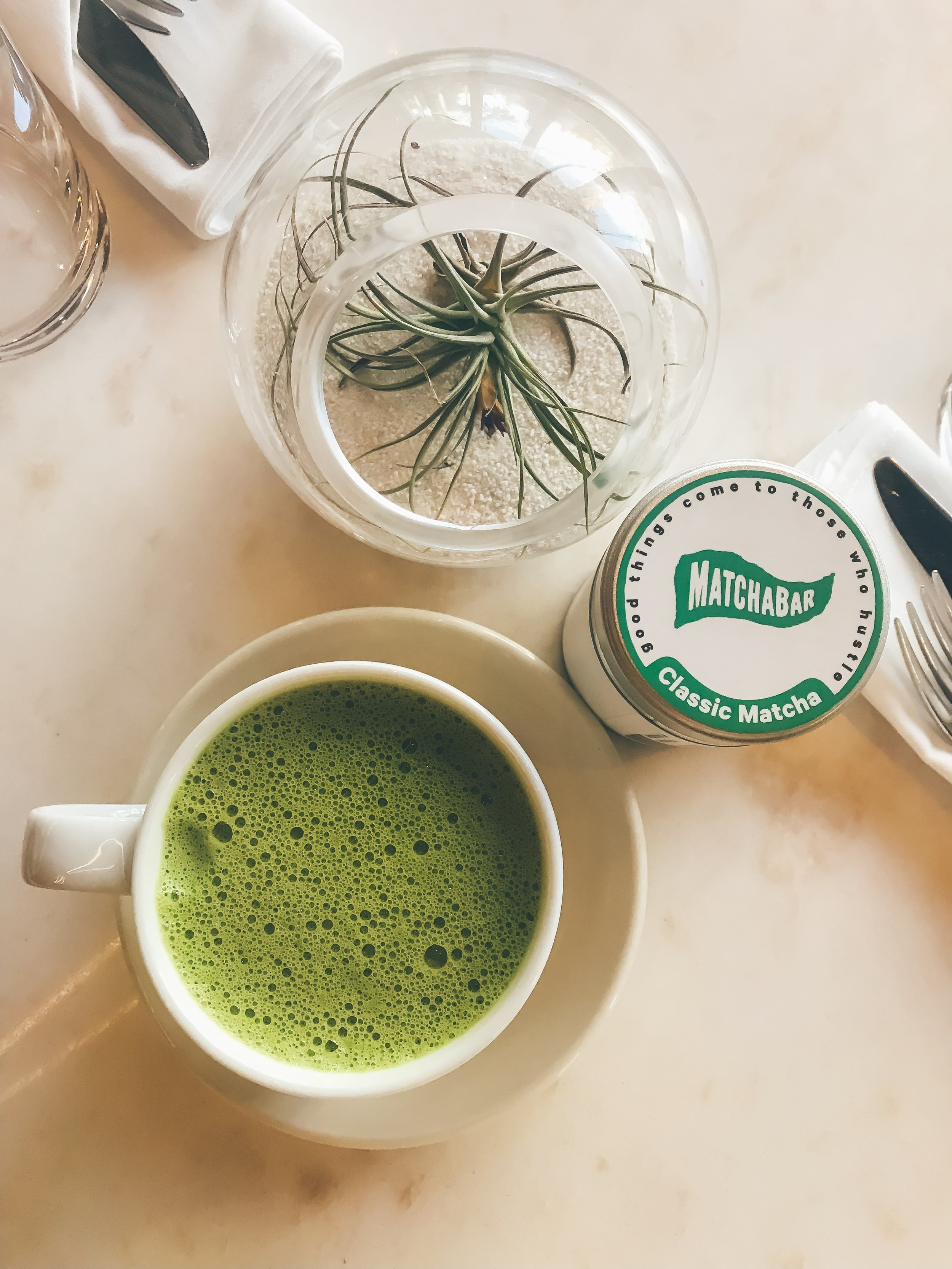 My Go-To Mindful Matcha - You can bring a tin of matcha with you easily in your carry-on luggage or simply in your everyday handbag. My favorite travel matcha is from my friends at Matcha Bar.Their matcha is light, airy, very high quality and always brings me right back to my center in the midst of a lot of travel and movement.I also love to have matcha on hand when I am flying, as all you need to do is ask for hot water and whisk in your matcha for an in-flight mindful matcha moment.Use code MATCHAAG for 25% off their newest matcha blend here.