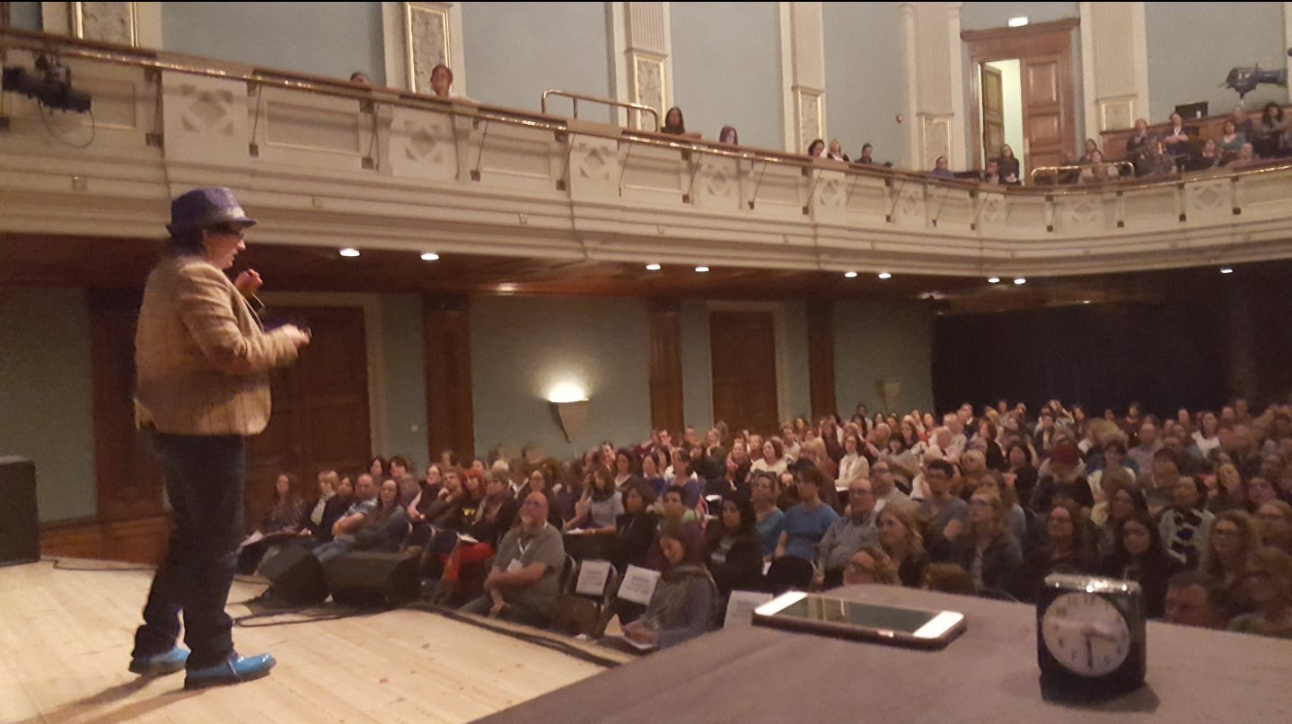 Photo of me speaking at Reading town hall on the same bill as Dr Temple Grandin