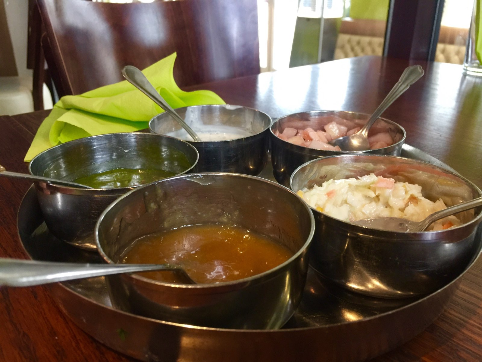 Food from every land, including this assortment of sauces from an Indian restaurant in Manchester.