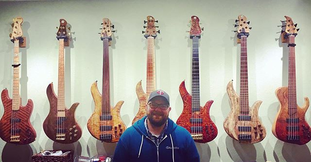 @soysquad taking in the @lonnybass wall of handcrafted bass #handbuilt #bassguitar #craft
