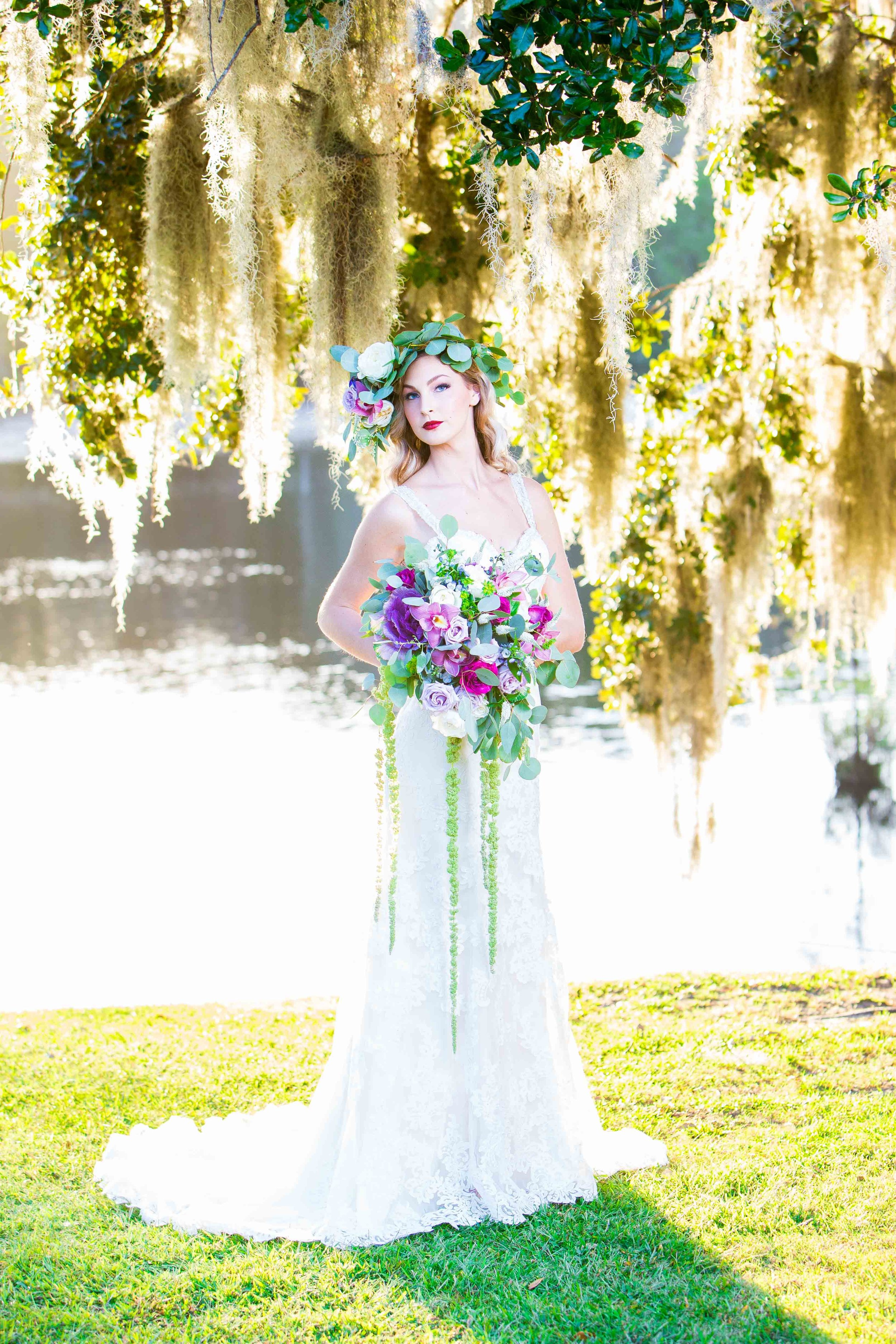 Bright bridal portrait on the waterfront with bride wearing floral crown
