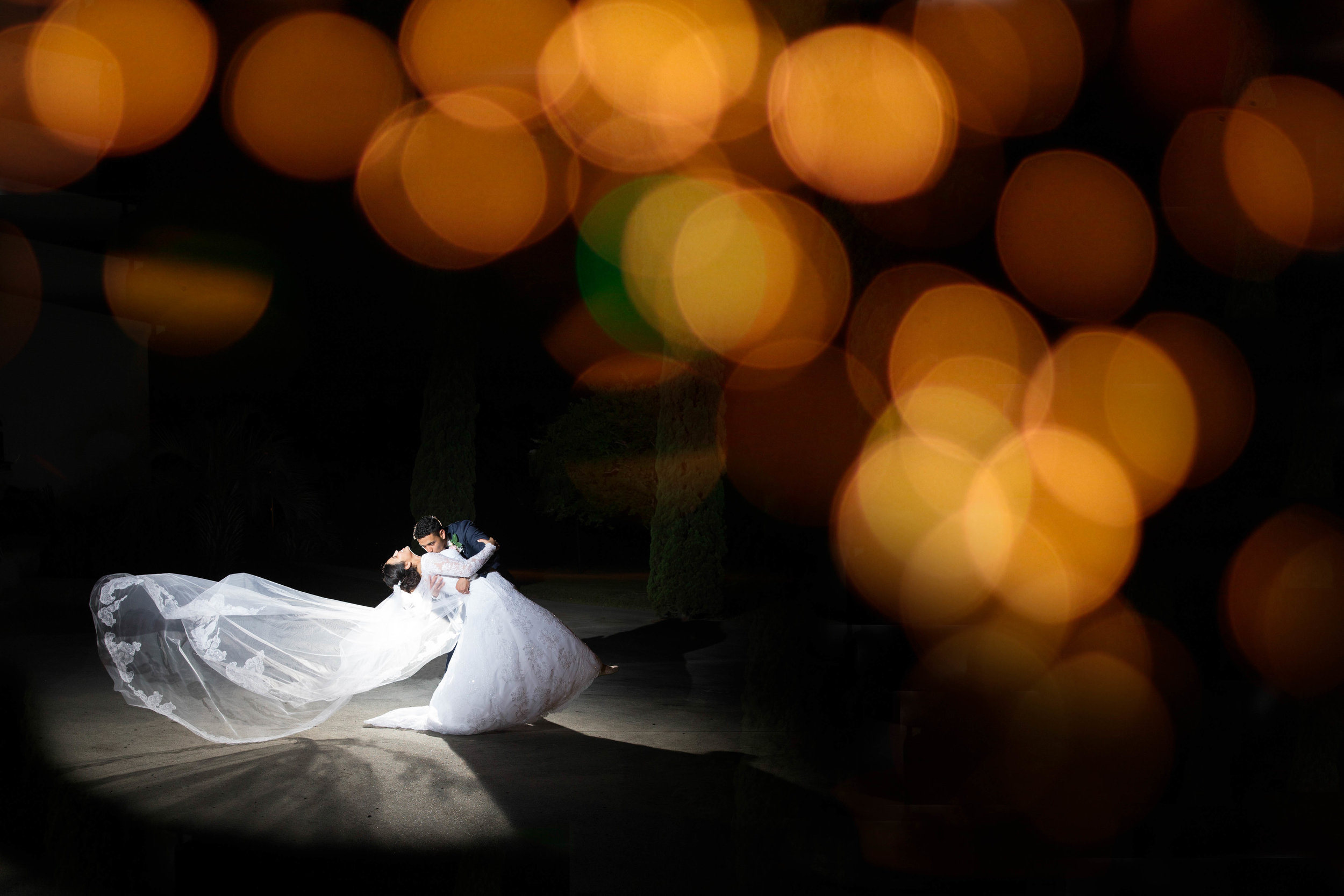 Stylish and dramatic shot of newlywed couple dancing together