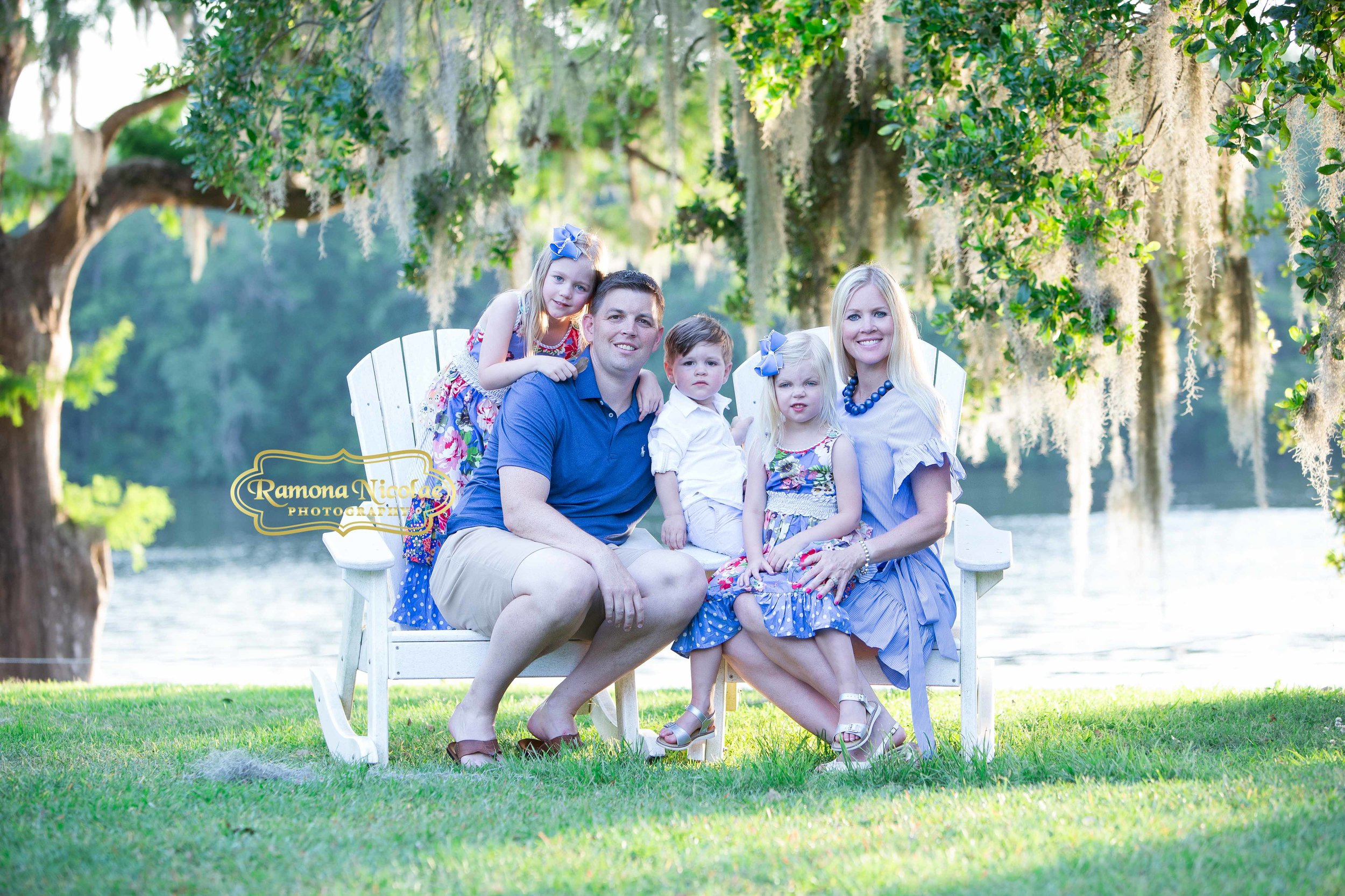gorgeous family pictures with children at wachesaw plantation wkith live oaks and spanish moss by the water.jpg