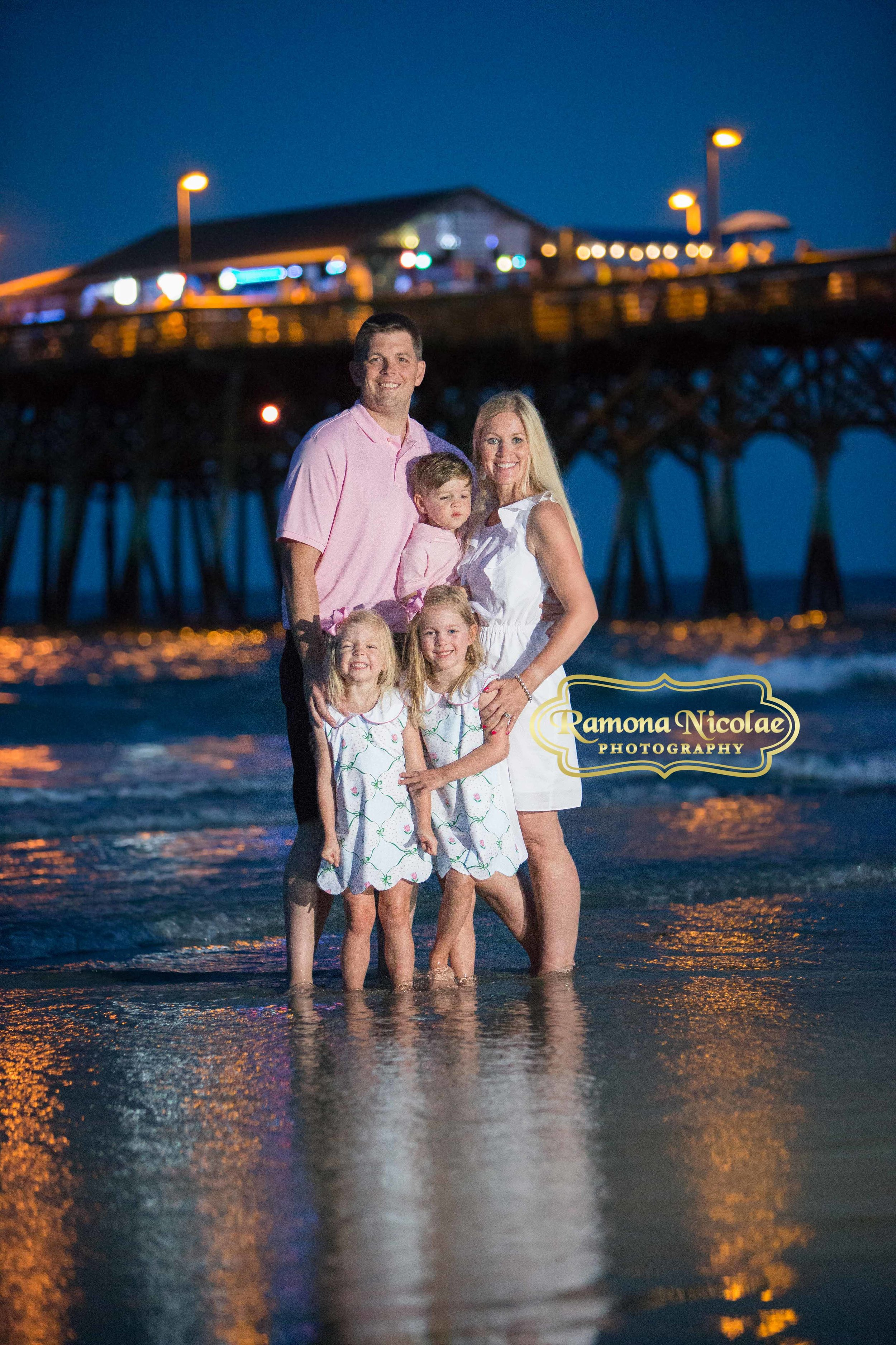 family picture by surfside pier in the water at night time.jpg
