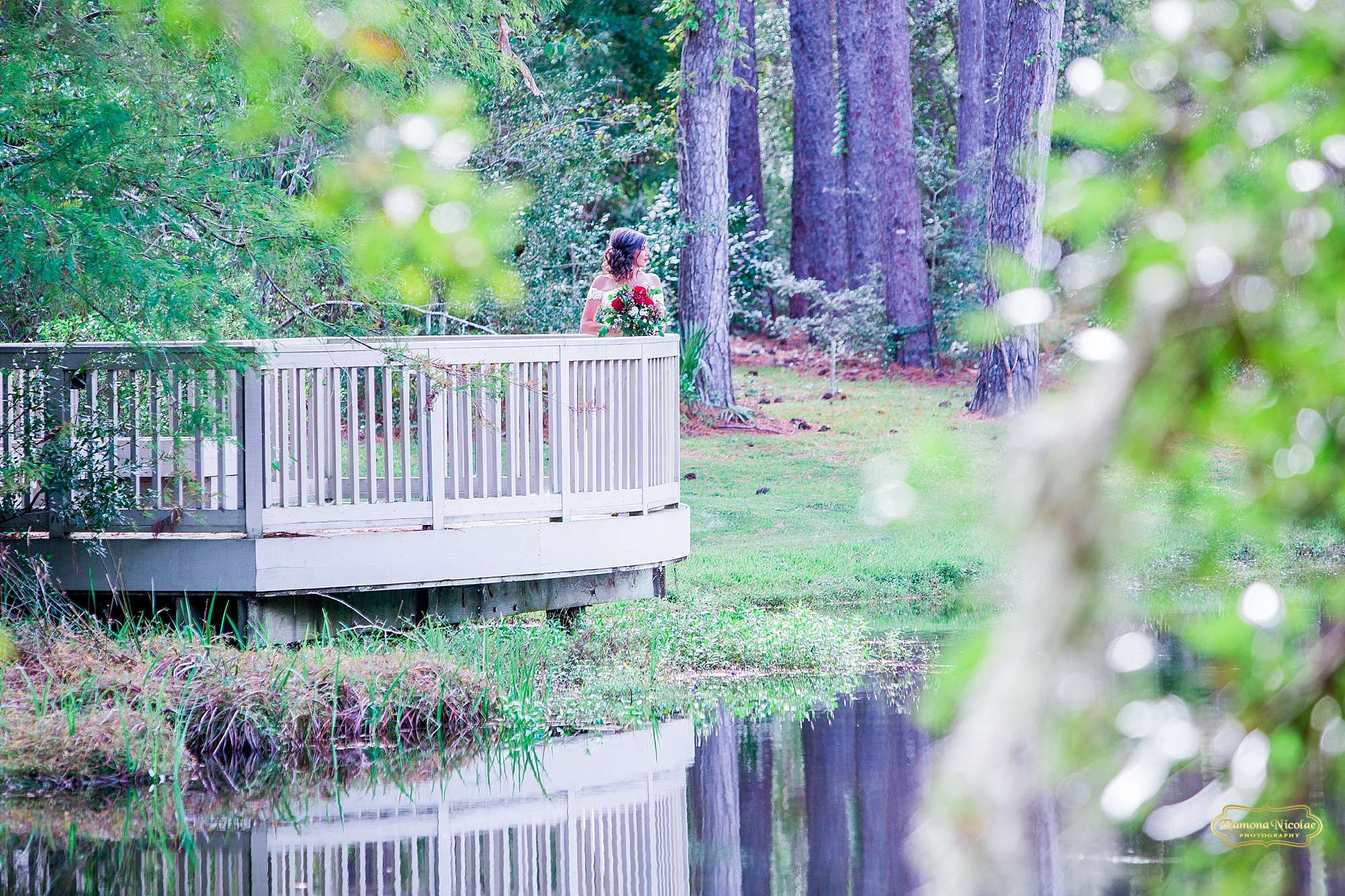 bride on a balcony by the water at brookgreen gardens for bridal session with ramona nicolae photography-1.jpg
