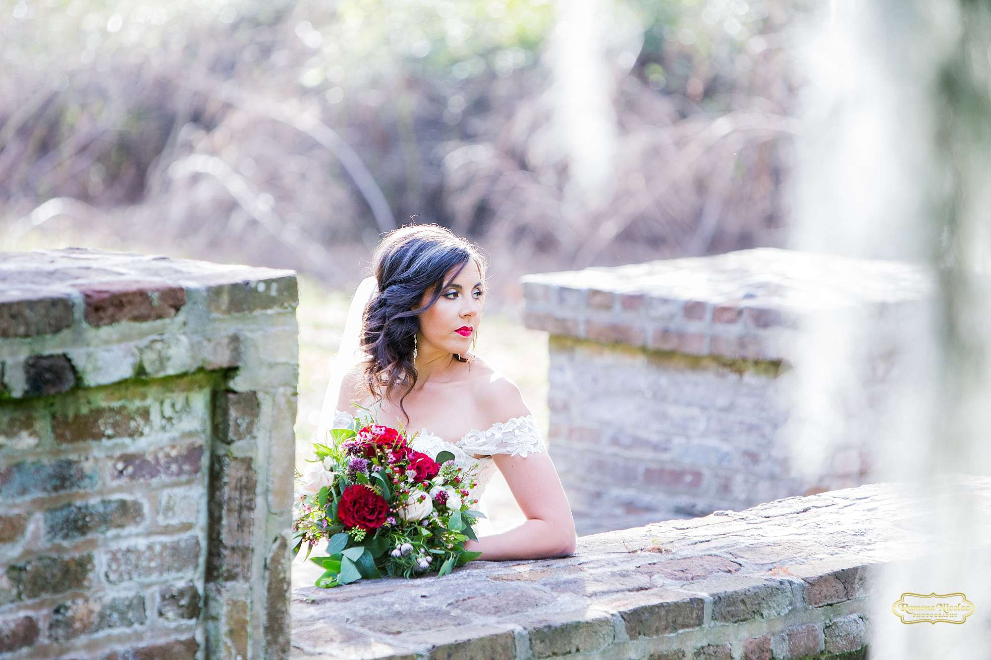 bride on the steps at brookgreen gardens with spanish moss for bridal session with ramona nicolae myrtle beach wedding photographer-4.jpg