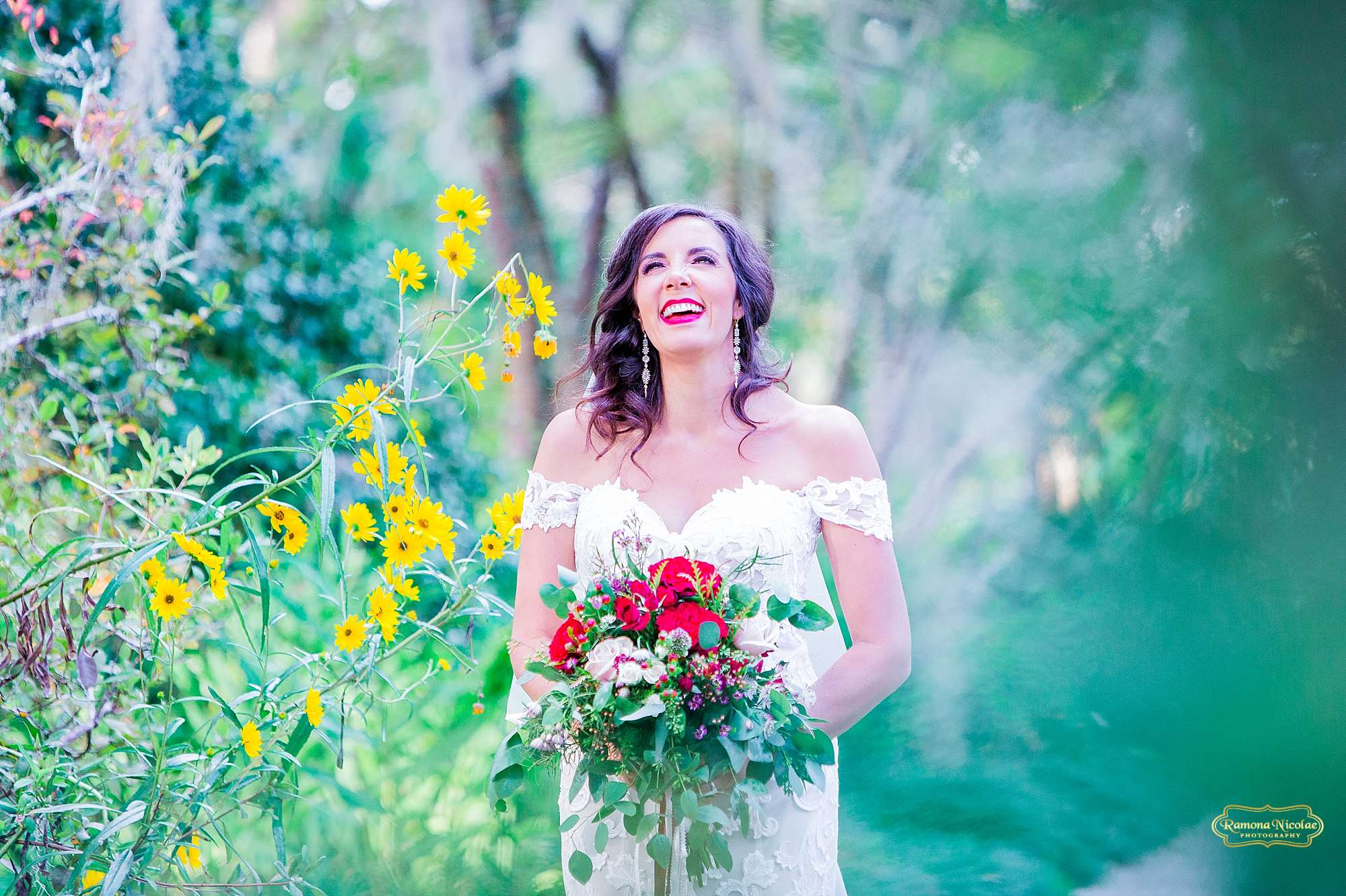 bride smiling surounded by flowers at brookgreen gardens for her bridal session with ramona nicolae photography in myrtle beach sc-3.jpg