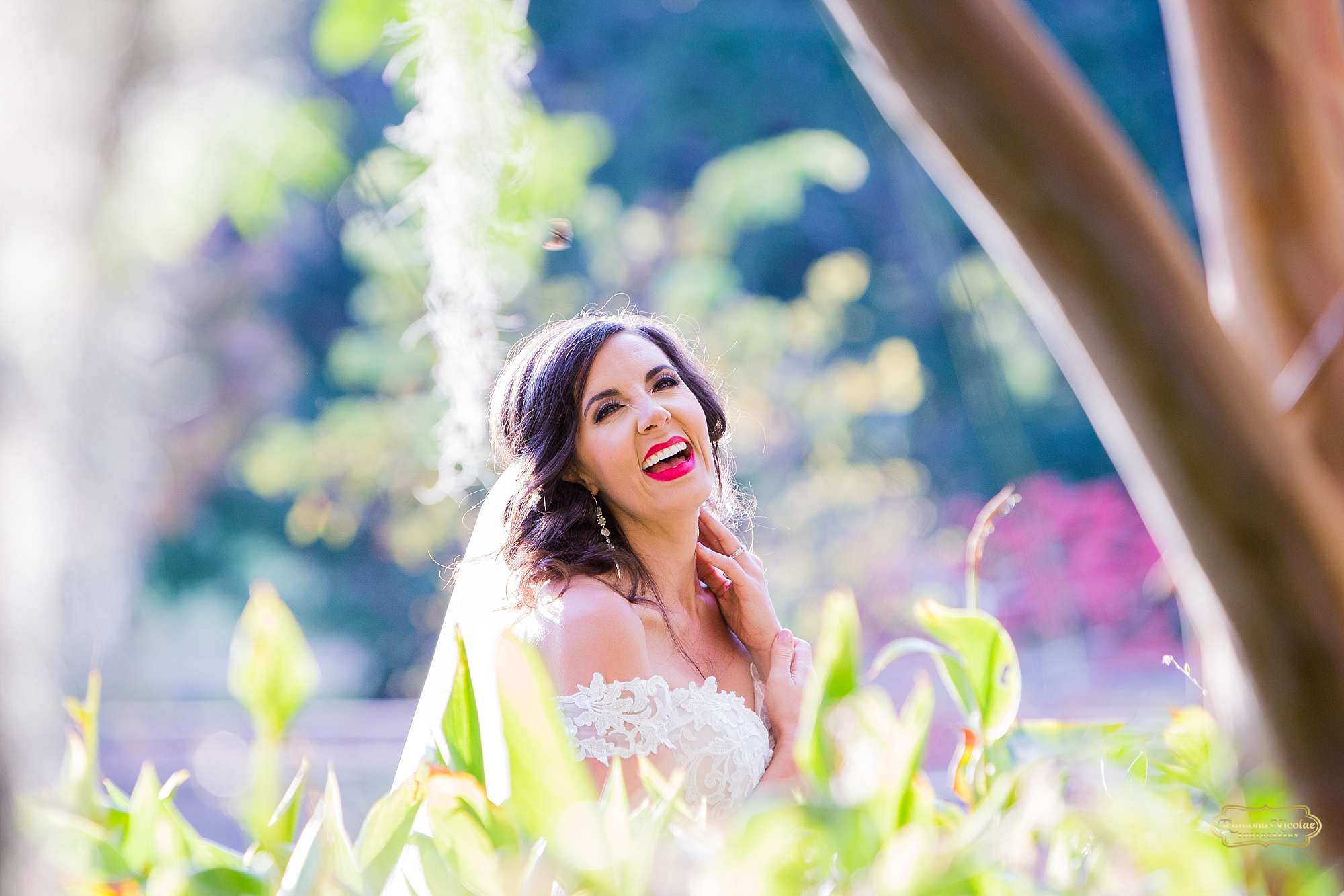 stunning bride between greenery with red lipstick at brookgreen gardens by ramona nicolae photography best myrtle beach photographer-4.jpg