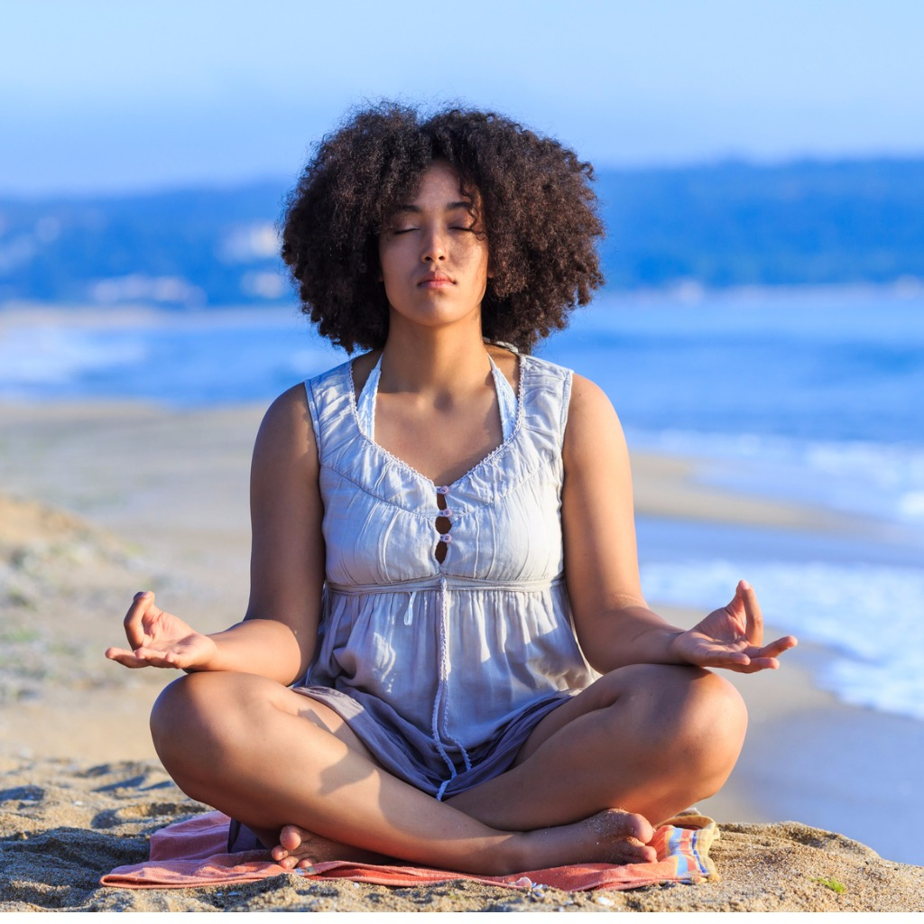 african-woman-sitting-on-sand-and-meditating-picture-id830353028.jpg