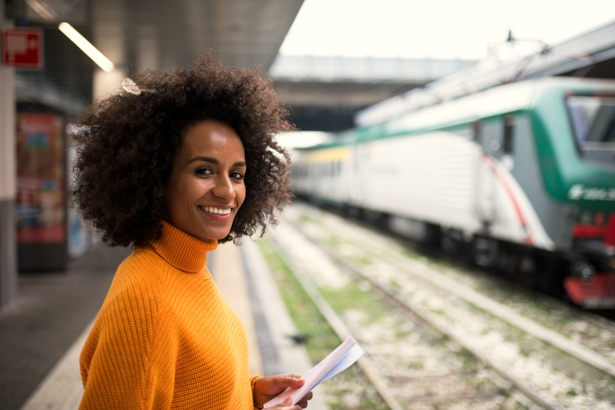 Black woman on train.png