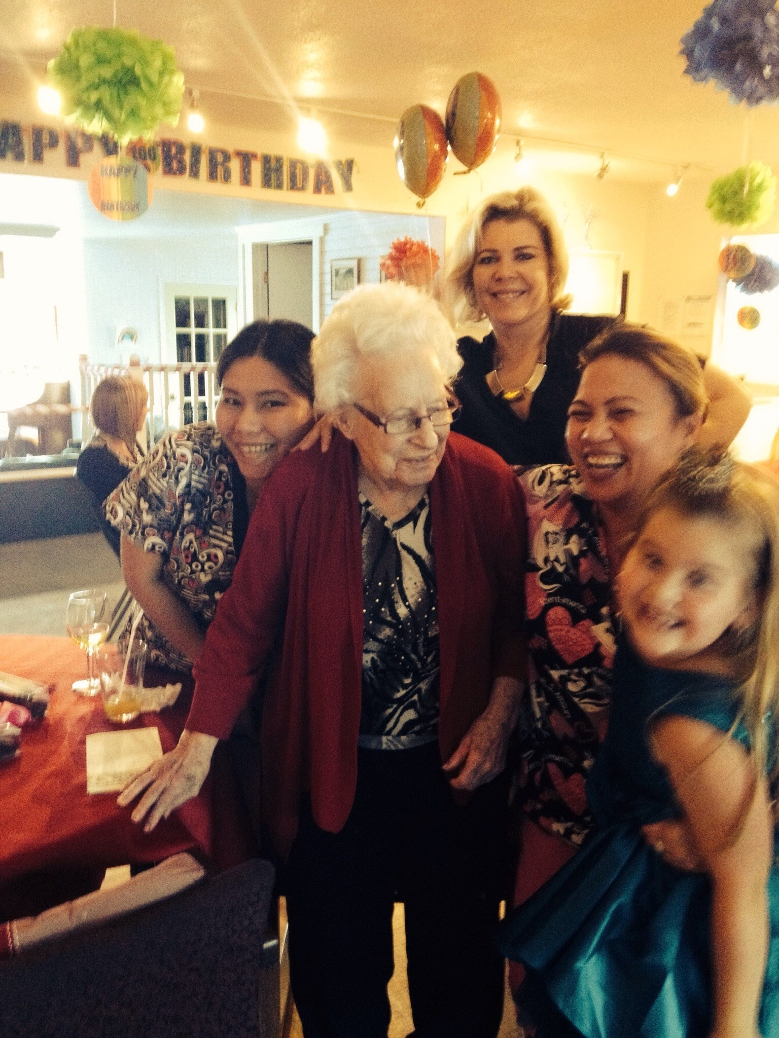 Staff celebrating a birthday with residents