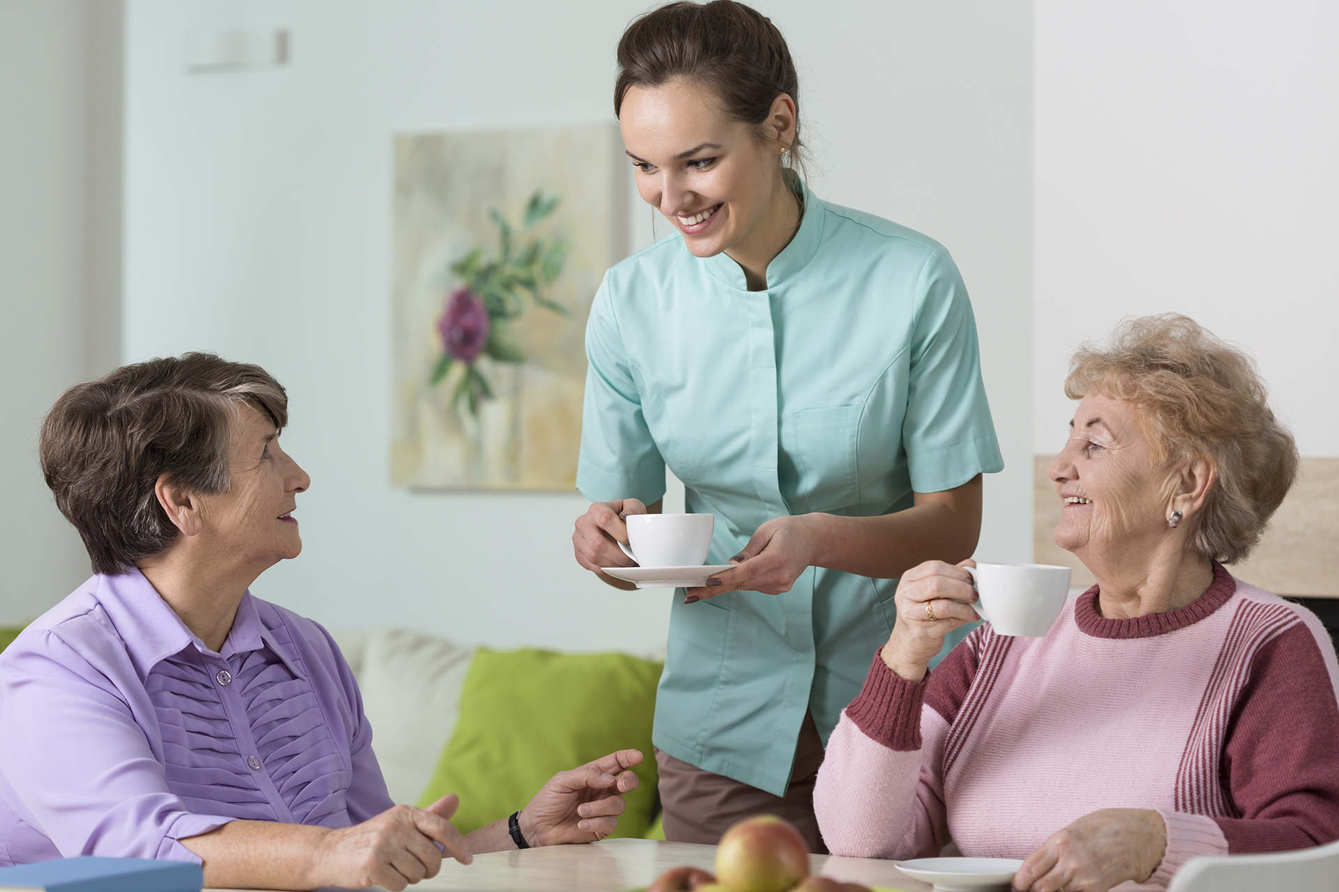 Staff helping seniors with tea