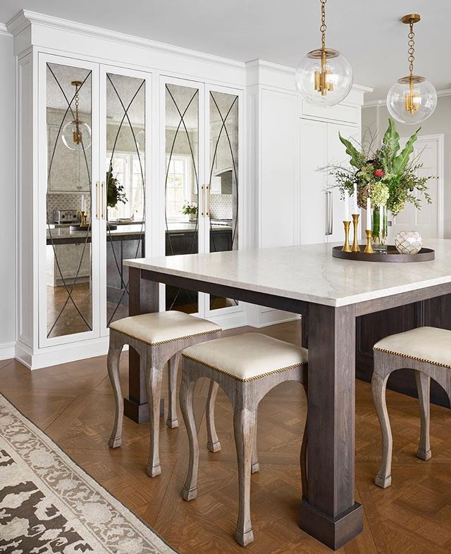 Custom lead glass antique mirror oversized cabinet doors! Totally makes this kitchen renovation. Scroll right for before of the same wall! • • • Photo : @rymcdon  Designer : @candy.scott #riverforestkitchenremodel #kitchendesign #riverforestkitchenandbath #chicagointeriordesigner #kitcheninteriordesigners #leadglasscabinets #parquettefloors #vintagekitchenremodel