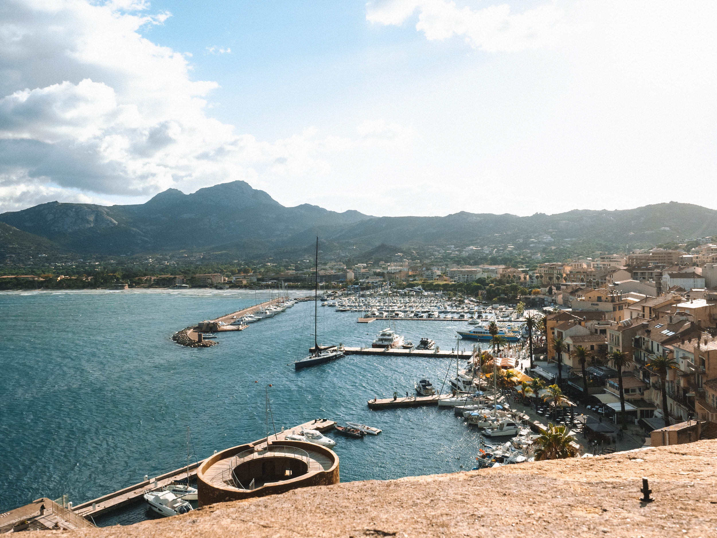Corsica is a beautiful, secluded island in the Mediterranean Sea. With countless hiking trails, pristine beaches and small towns, it's the perfect way to escape the hustle of a European vacation for a few days. Take a quick flight to Calvi, Corsica for an amazing experience different than anywhere else in France! #france #corsica #hiking #island