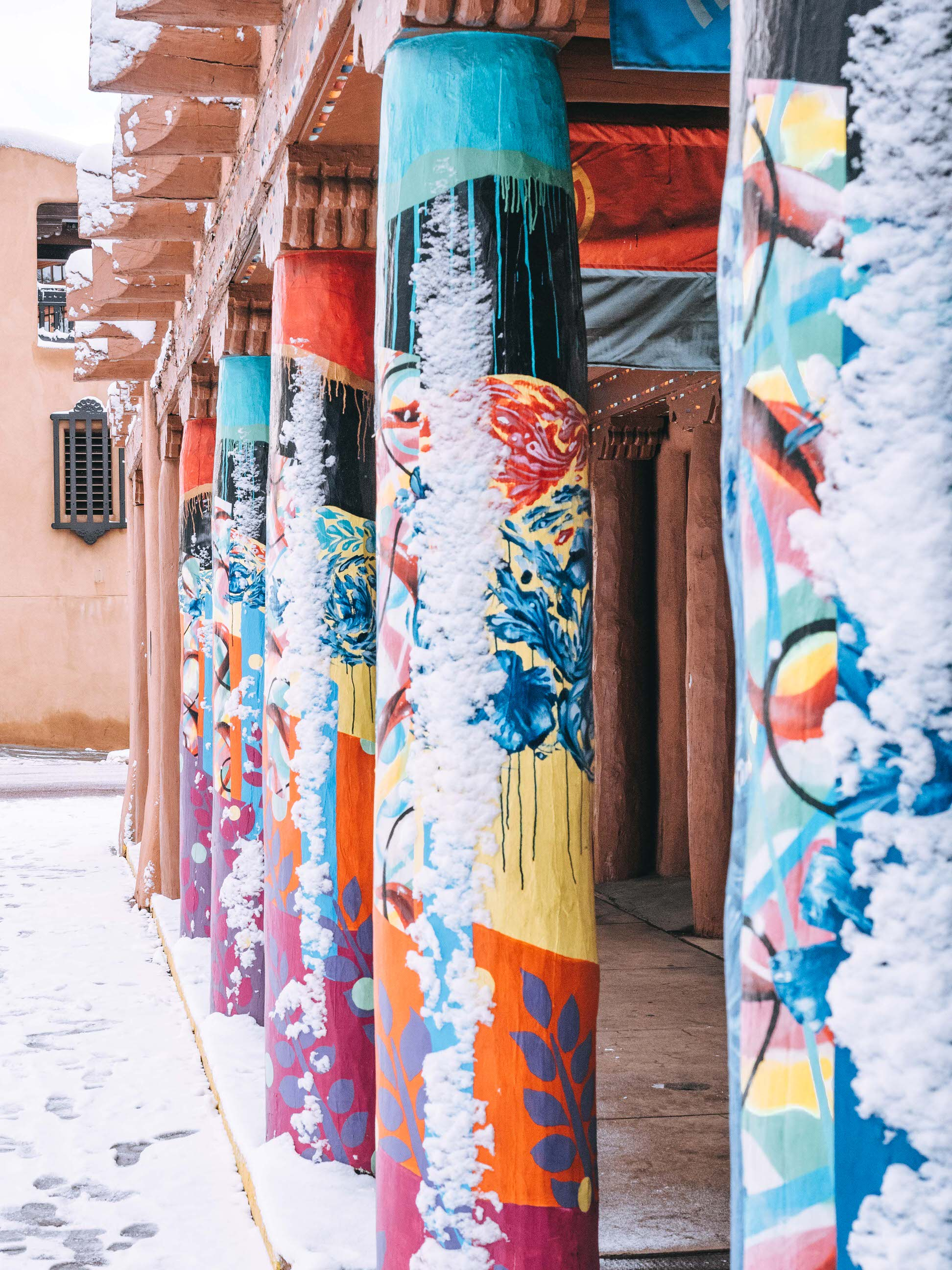 There are a lot of reasons why you should visit Santa Fe: the countless art galleries, the amazing local food, the unique museums and even the shopping! But visiting Santa Fe, New Mexico in the winter will bring the warmth of the Southwest to your cold weather vacation, even when there is snow on the ground. Make sure you add Santa Fe to your winter travel bucket list! #travel #santafe #itinerary