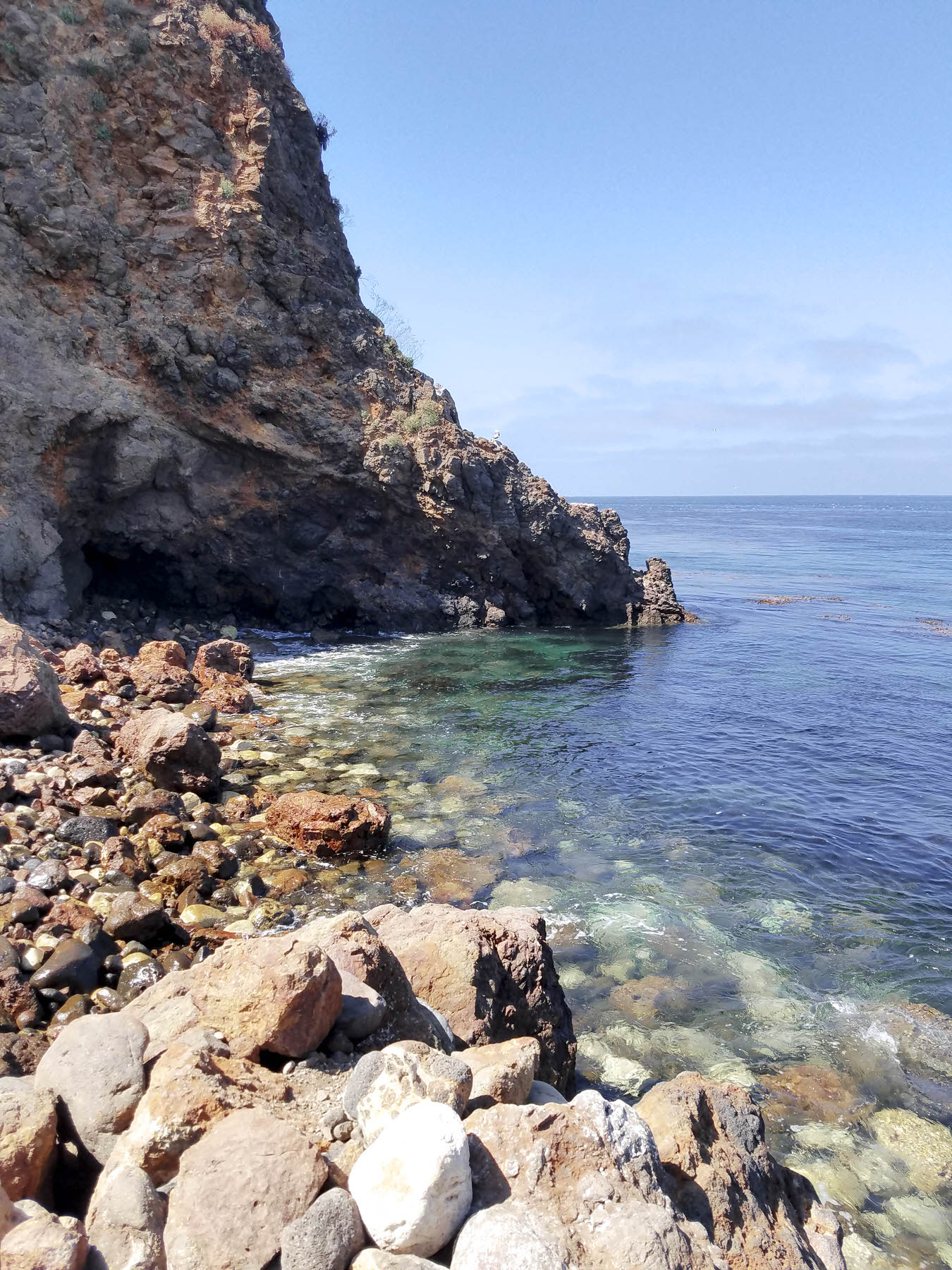 Try sea kayaking in island caves, snorkeling or hiking while exploring Channel Islands National Park off the coast of California. This remote park is an incredible place to experience nature away from large groups of tourists. Channel Islands kayaking should be at the top of everyone's travel list. #nationalpark #california #kayaking #hiking #traveldestinations