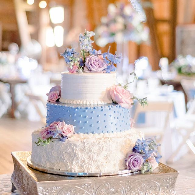 Phew. It's Monday. I sure hope your day is a piece of cake. 🤪 I am thinking I need another cup of coffee to spring me into action.  Isn't this a great shot?! @catalkirephoto was able to make the barn @stjoefarm sparkle for @emencias1 💯💯💯 . Venue: @stjoefarm  Photographer: @catalkirephoto  Cake: @carmelasatmacris  Event Design: @julie_glick Rentals: @aayseventrentals . . . . #floradashery #weddings #weddingflowers #cake #barnwedding #indianawedding #thatsdarling #floralstories #bestdayever #flowers
