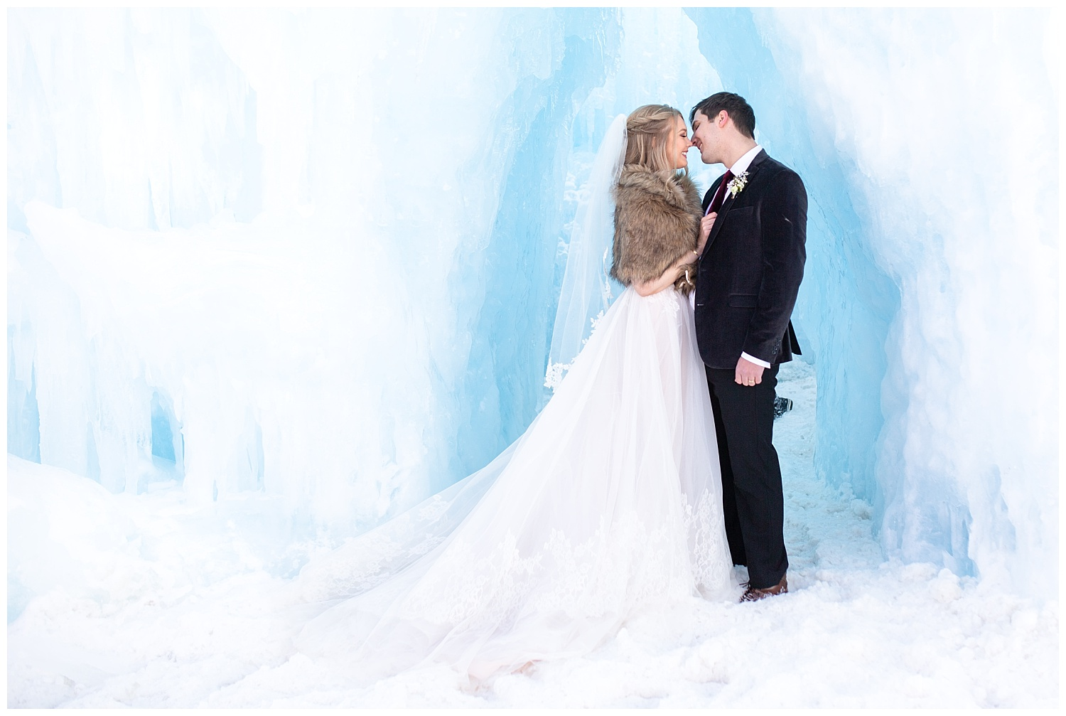 a bride and groom almost share a kiss underneath a beautiful ice sculpture