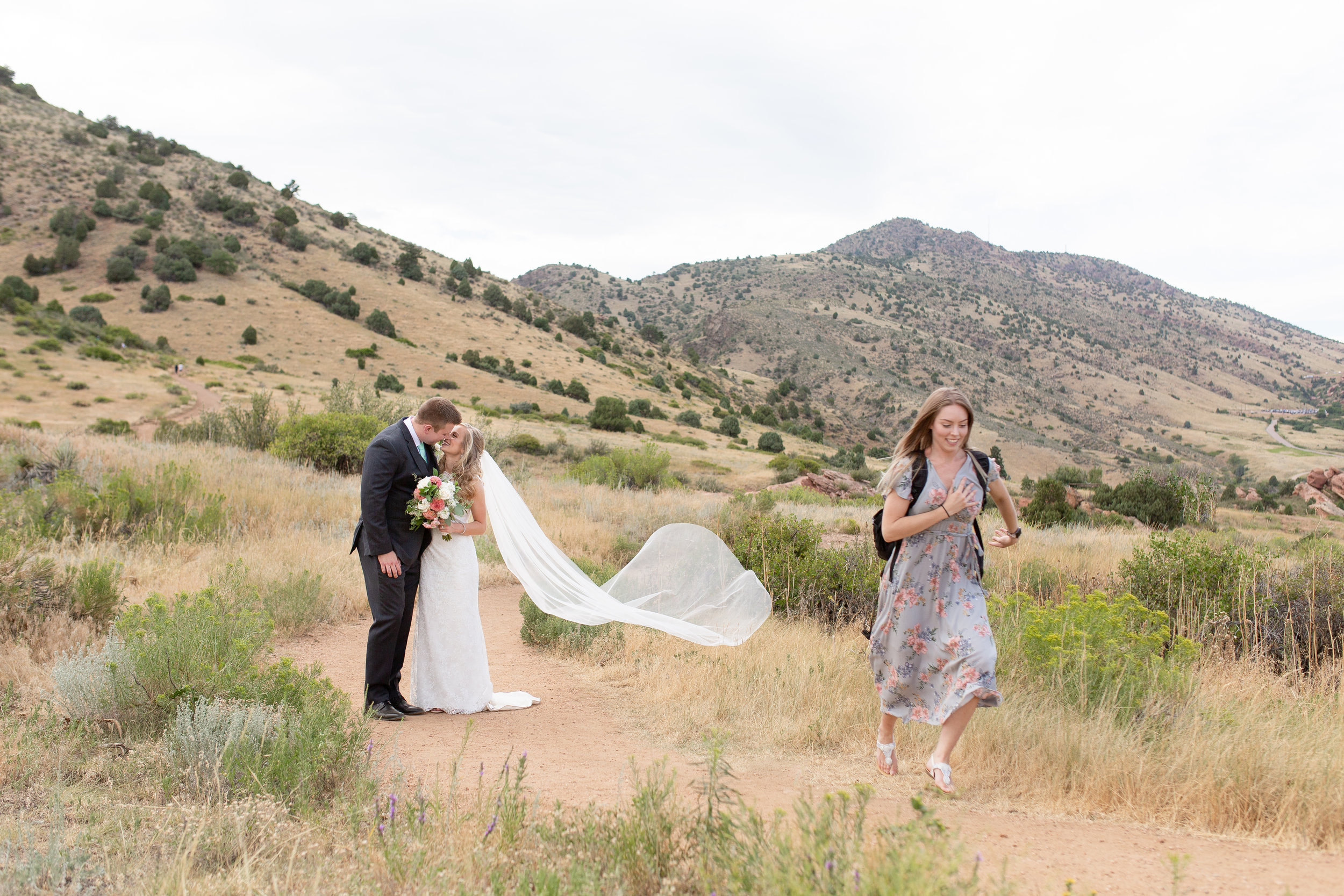 Jenna - my sister - was my assistant for this wedding. She helped lug my gear around and kept us on schedule, but she also tossed the veil and dashed for me. Here's Jenna in action!