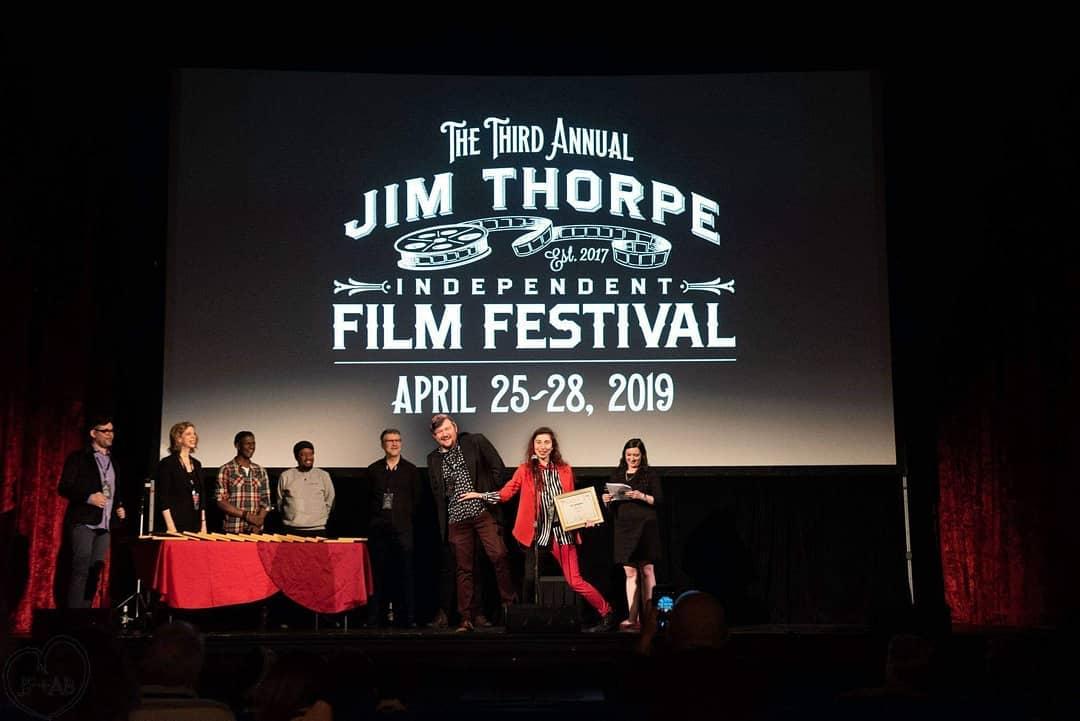 "Director Kira Bursky winning ""Best Experimental Film"" at Jim Thorpe Independent Film Festival for ""Period."""