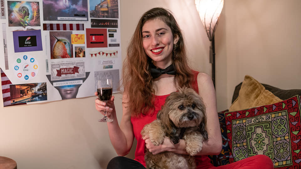 All Around Artsy Owner / Director Kira Bursky with her dog Alfie in front of her 2019 Vision Board on New Year's Day.